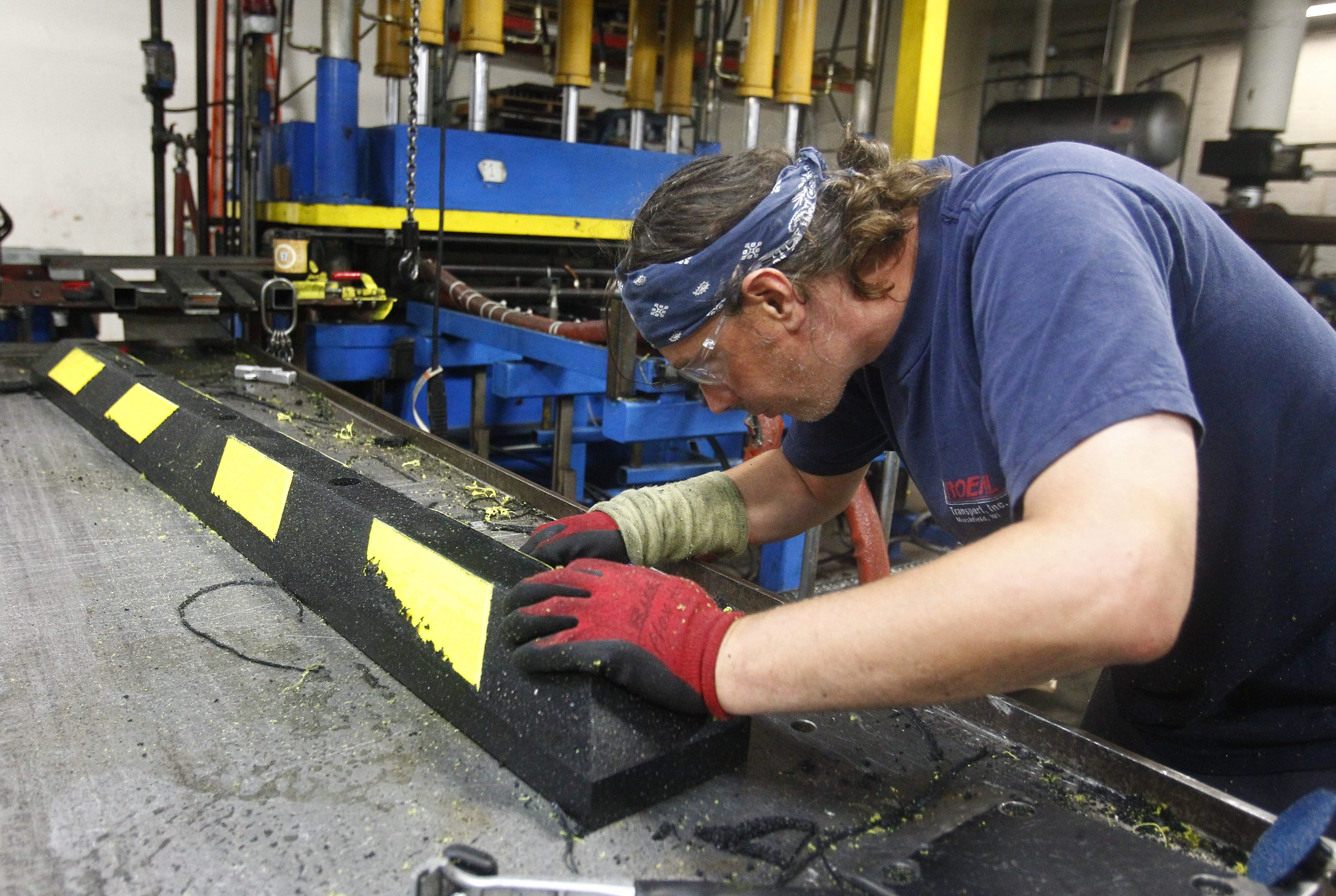 Mike Clapsaddle, a molder at the RubberForm Recycled Products plant in Lockport, works on a wheel stop as the company is preparing to increase its 16-member workforce by six to eight employees and add a second production shift for this fall.