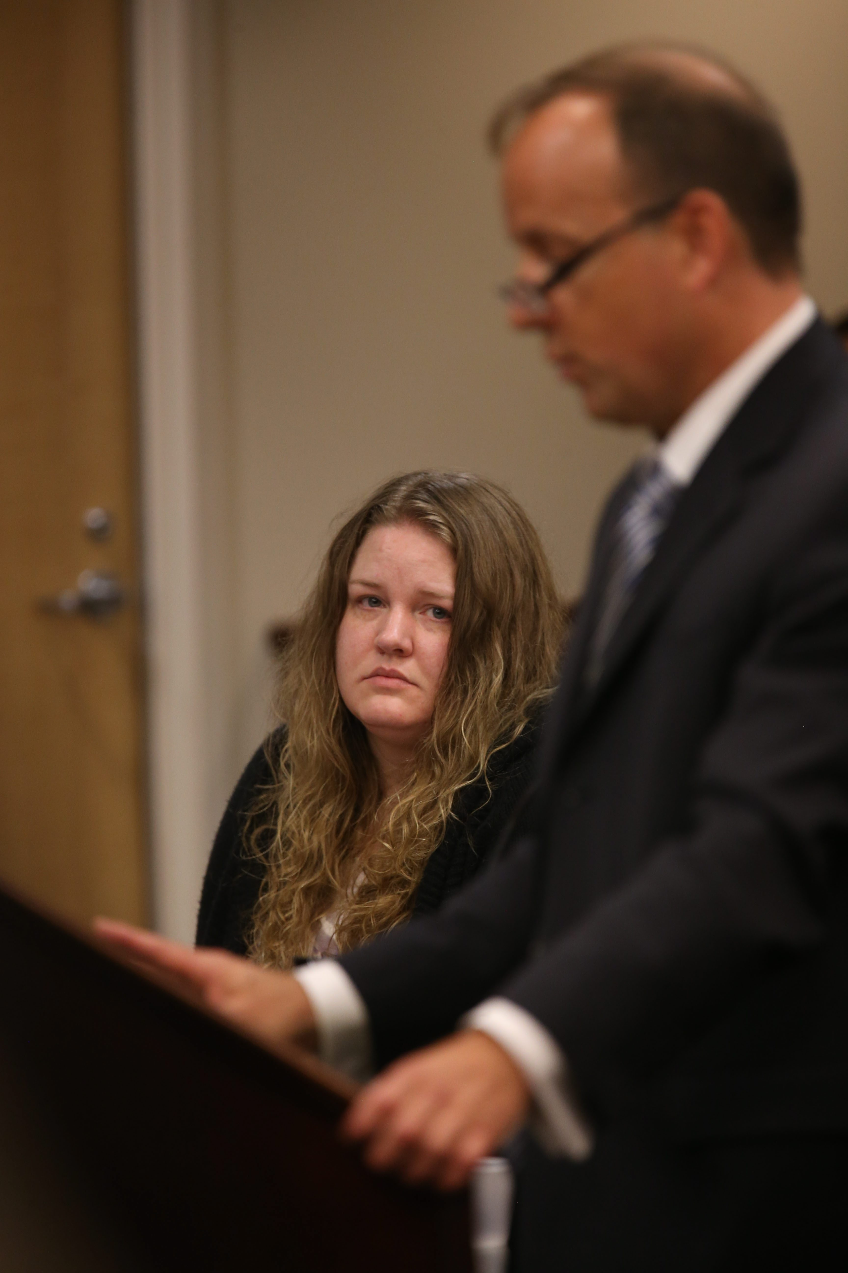 Candance Croff Cartagena watches Assistant District Attorney Tom Finnerty give closing remarks Wednesday.