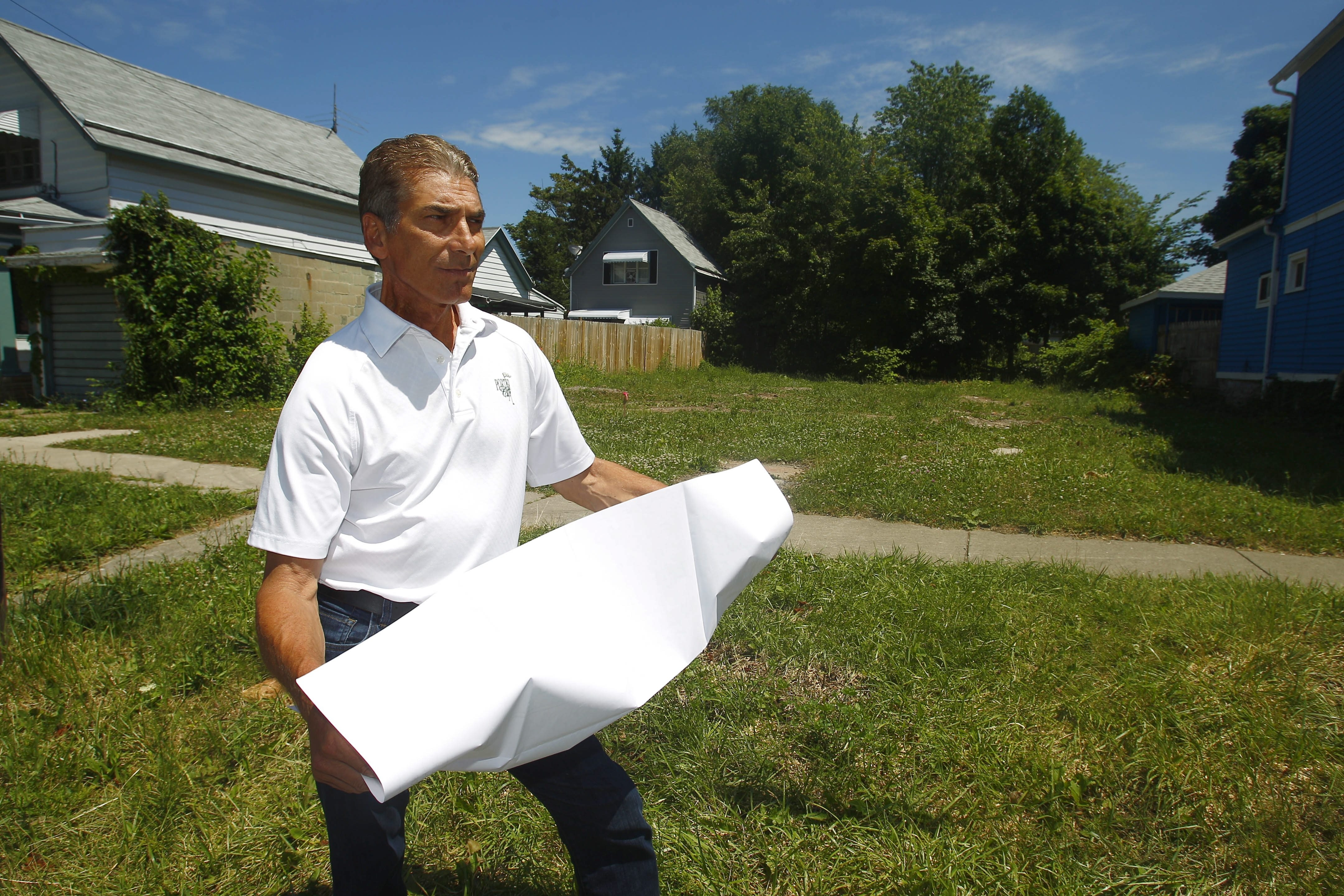 Joel Giambra, former Erie County executive, is getting into the redevelopment act, with plans to build new single- and multi-family homes on the Lower West Side.