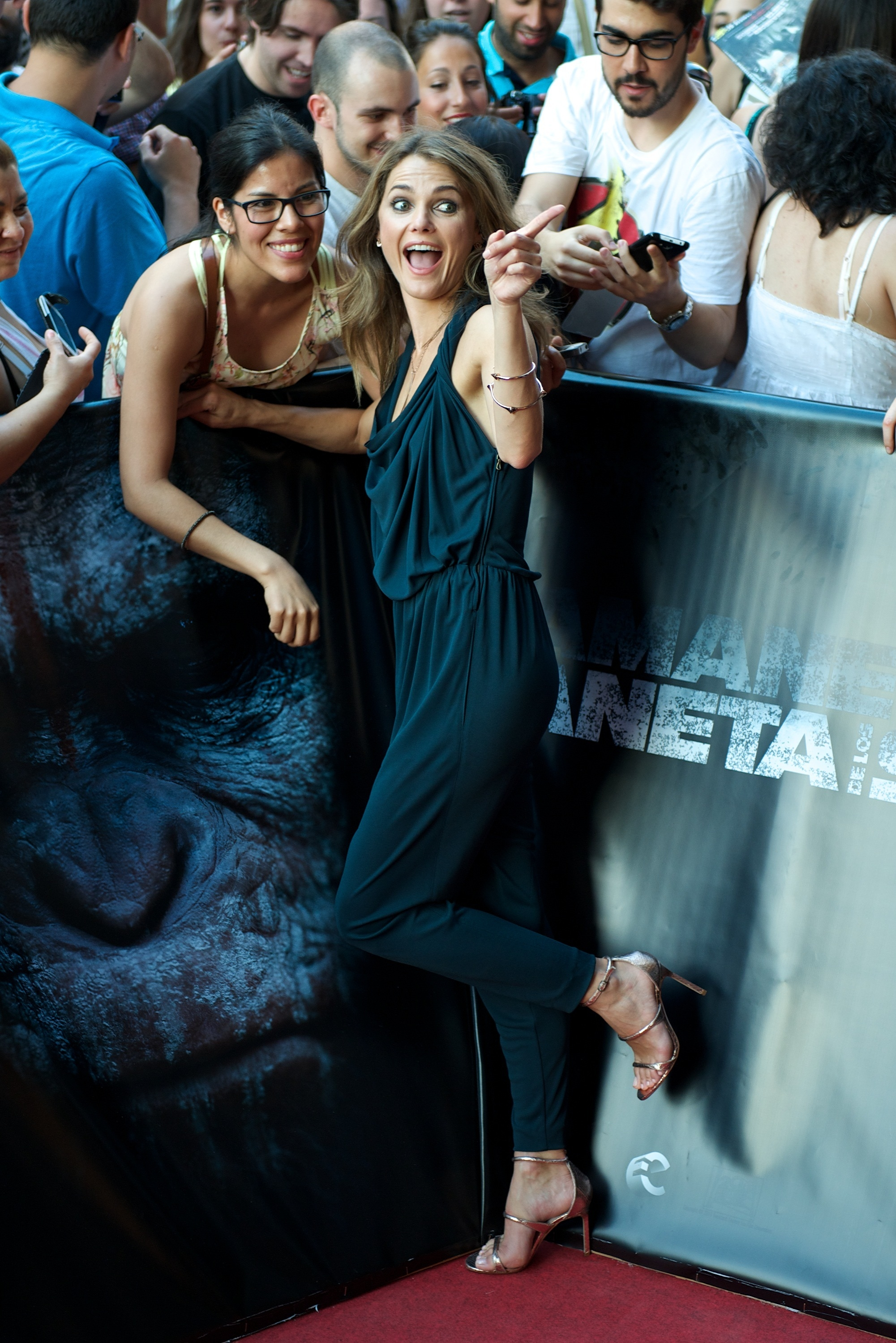 """Monkeying around: Actress Keri Russell works the crowd at the premiere of the film """"Dawn of the Planet of the Apes"""" on Wednesday in Madrid."""