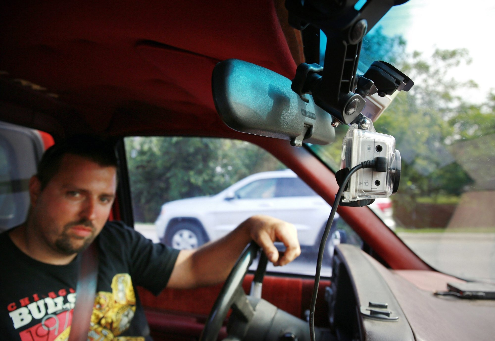 Joe Elbaor drives home from work with his dashboard camera mounted below the rearview mirror of his truck last month in Itasca, Ill. Elbaor uses the camera to record videos of bad driving and then posts them on his YouTube account.