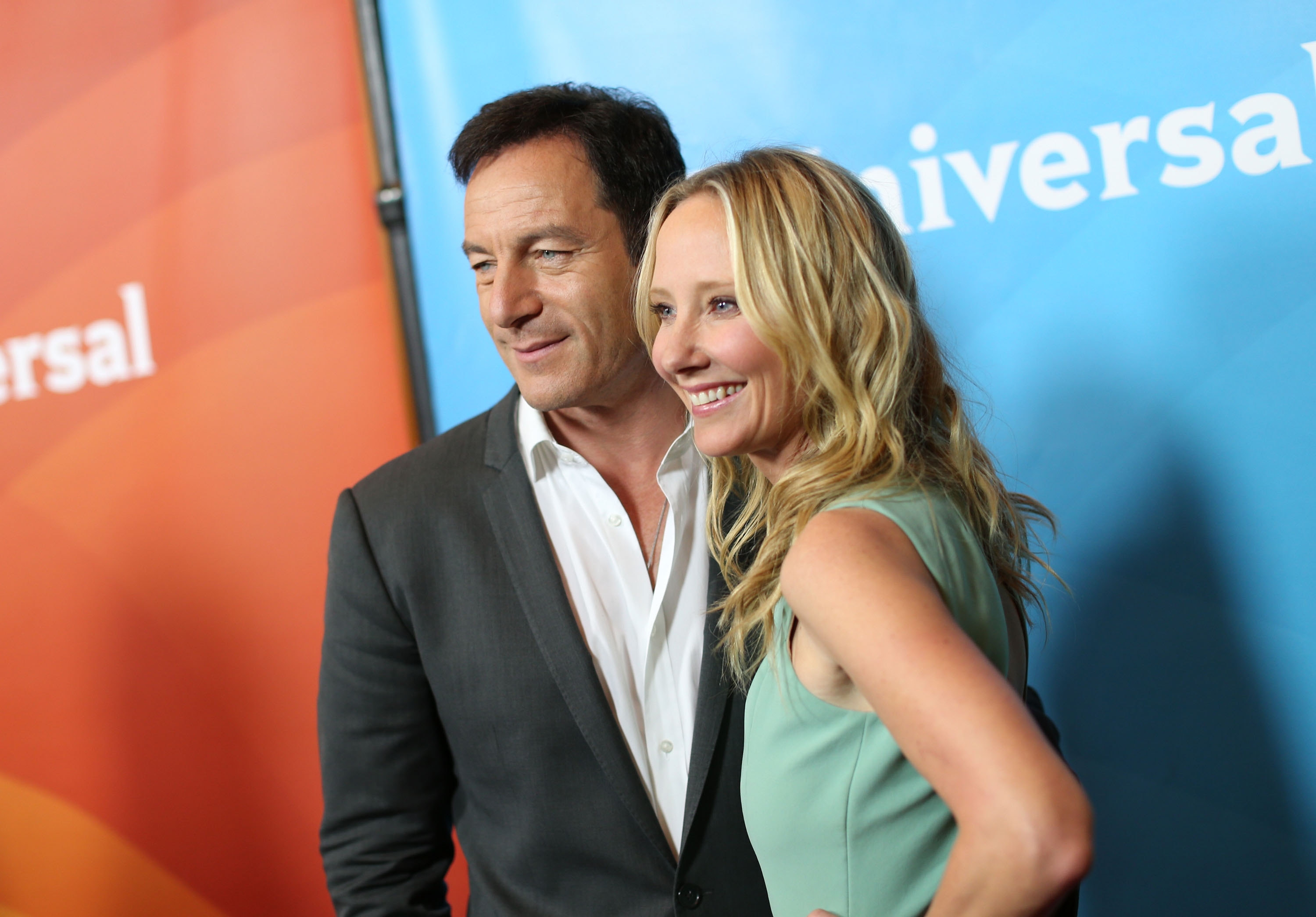 Making an entrance: Actor Jason Isaacs and actress Anne Heche attend NBC Universal's 2014 Summer TCA Tour on Monday in Beverly Hills, Calif.