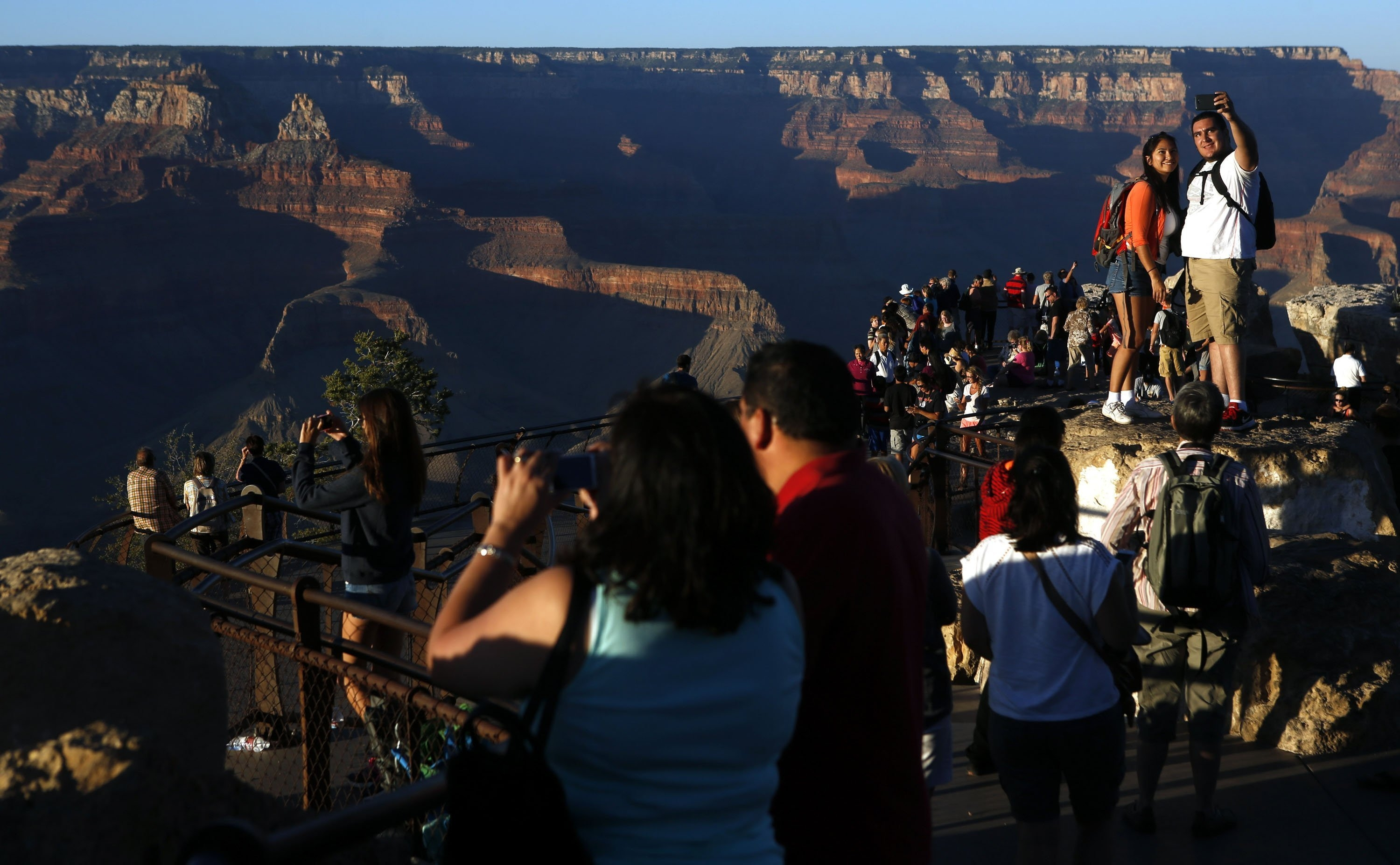 Visitors take in the view of the Grand Canyon at Mather Point on the Southern Rim in January. The town of Tusayan, Ariz., has proposed adding commercial development near the canyon that is being fought by the National Park Service.