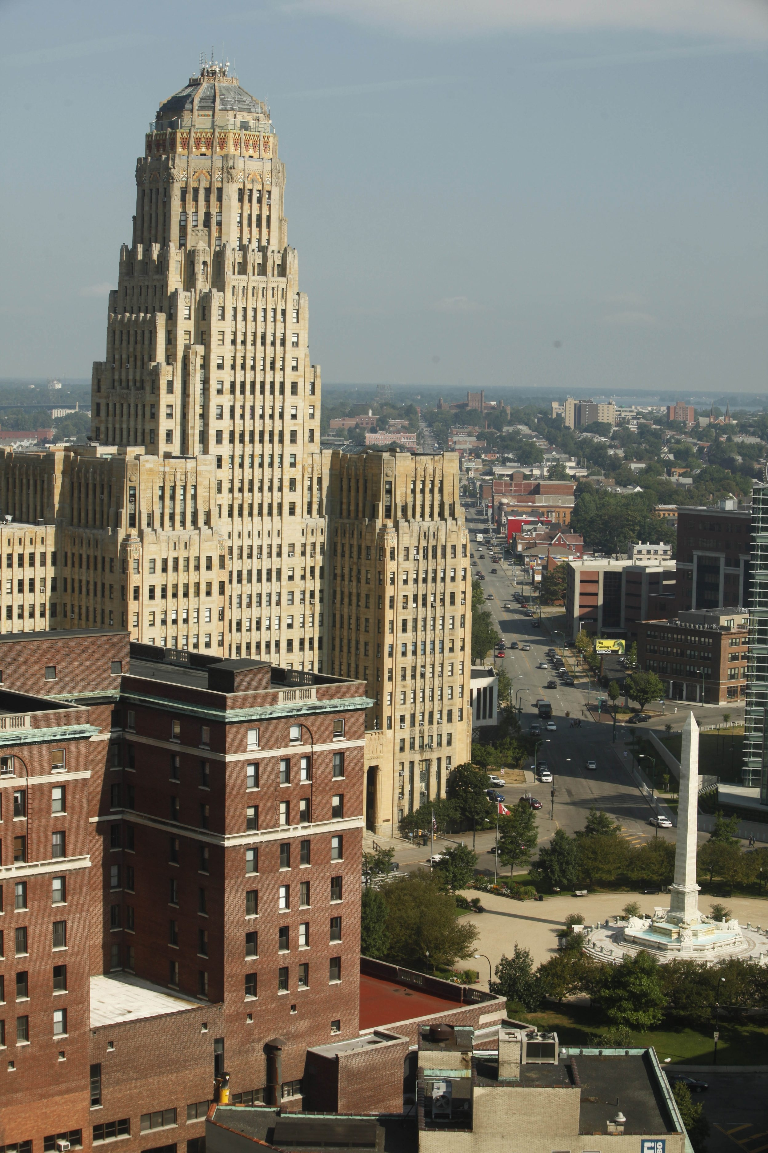 { FOR FILE } Buffalo City Hall towers over Niagara Square, as viewed from the 16th floor of the Rath Building, Monday, July 16, 2012.  {Photo by Derek Gee / Buffalo News}