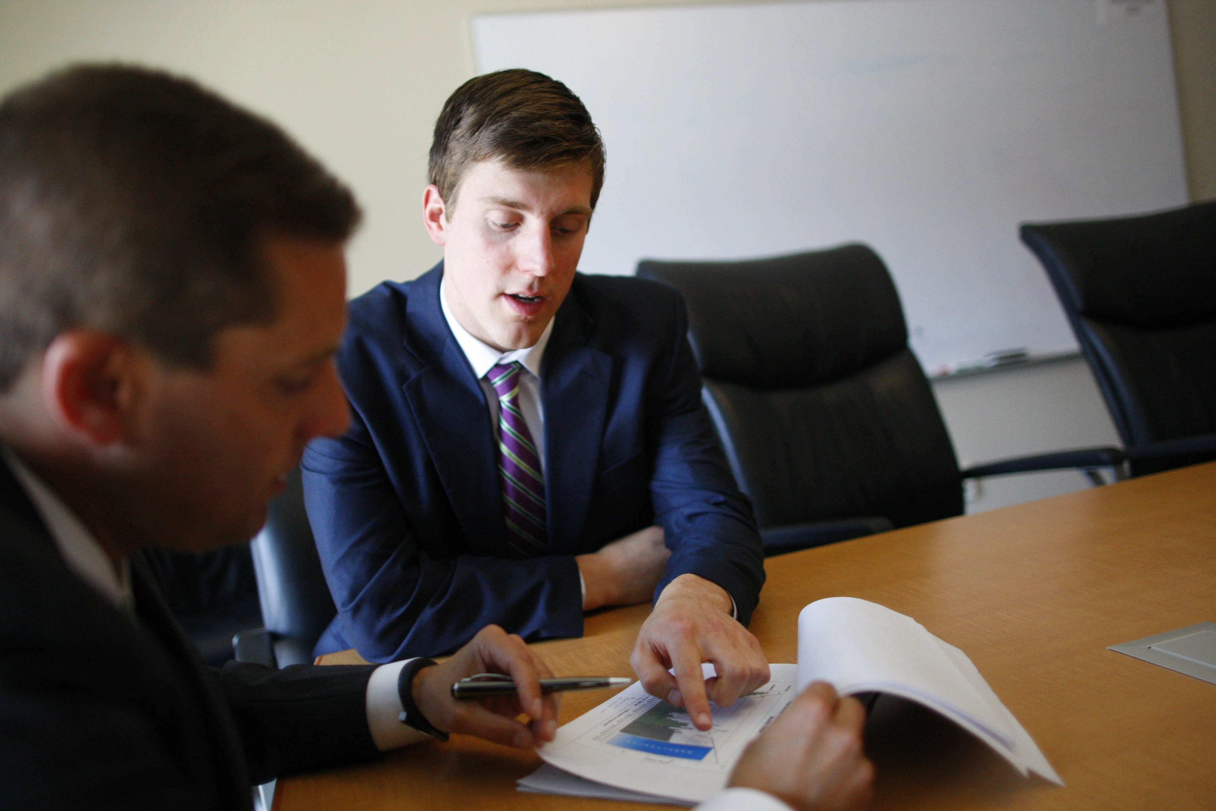Taylor Hogenkamp, a management trainee at M&T Bank Securities, recently completed the Management Development Program, Thursday, July 17, 2014.  Here he looks over a spreadsheet with Bart Kresse, vice president of product management at M&T Securities.  (Derek Gee/Buffalo News)