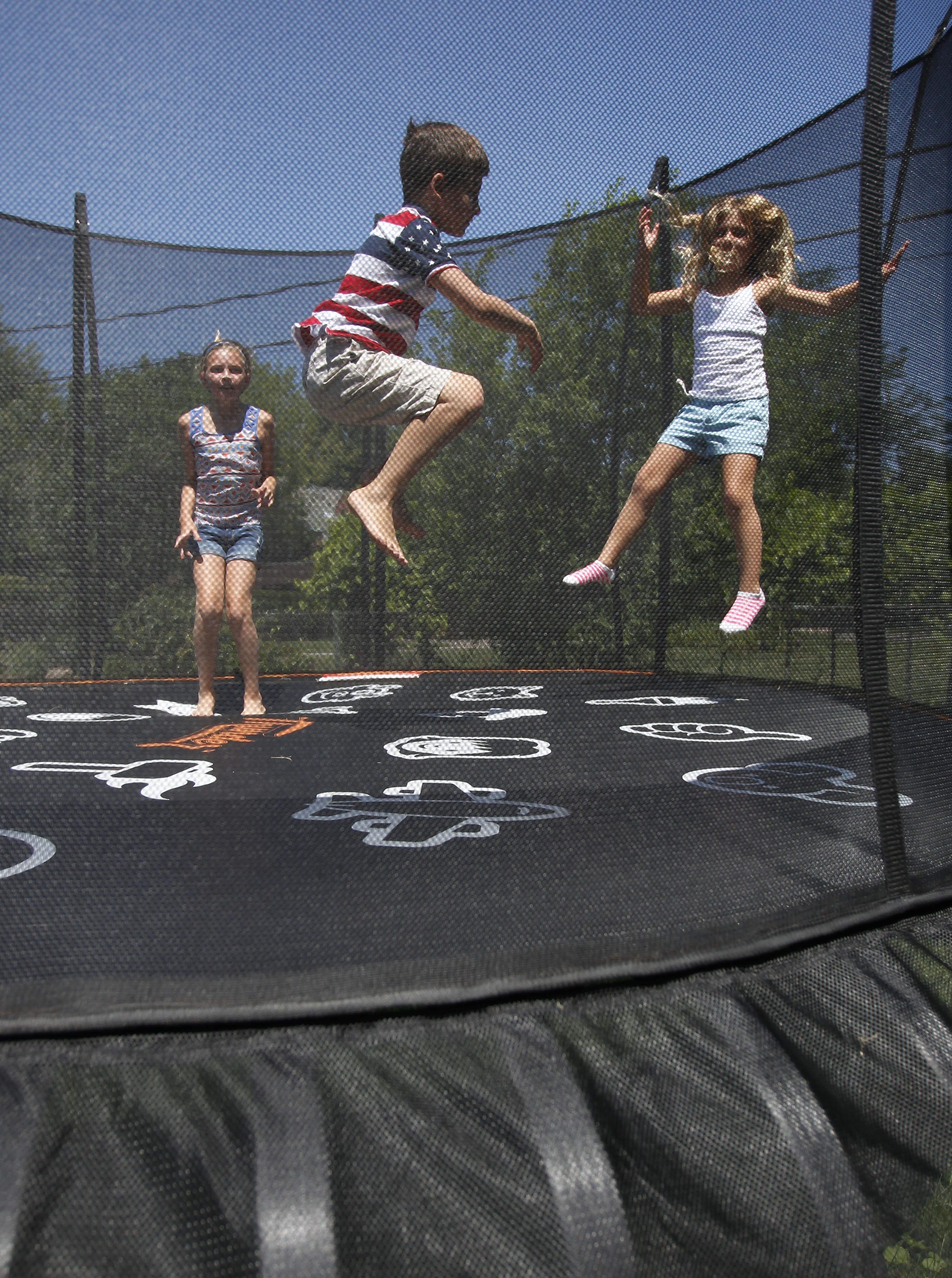 Ready, set, jump: Amy Habib Rittling of Amherst and her husband, Mark, bought a Vuly Thunder trampoline for summer fun. From left are a niece, Hailey Boyle, and A.J. and Haleigh Rittling.