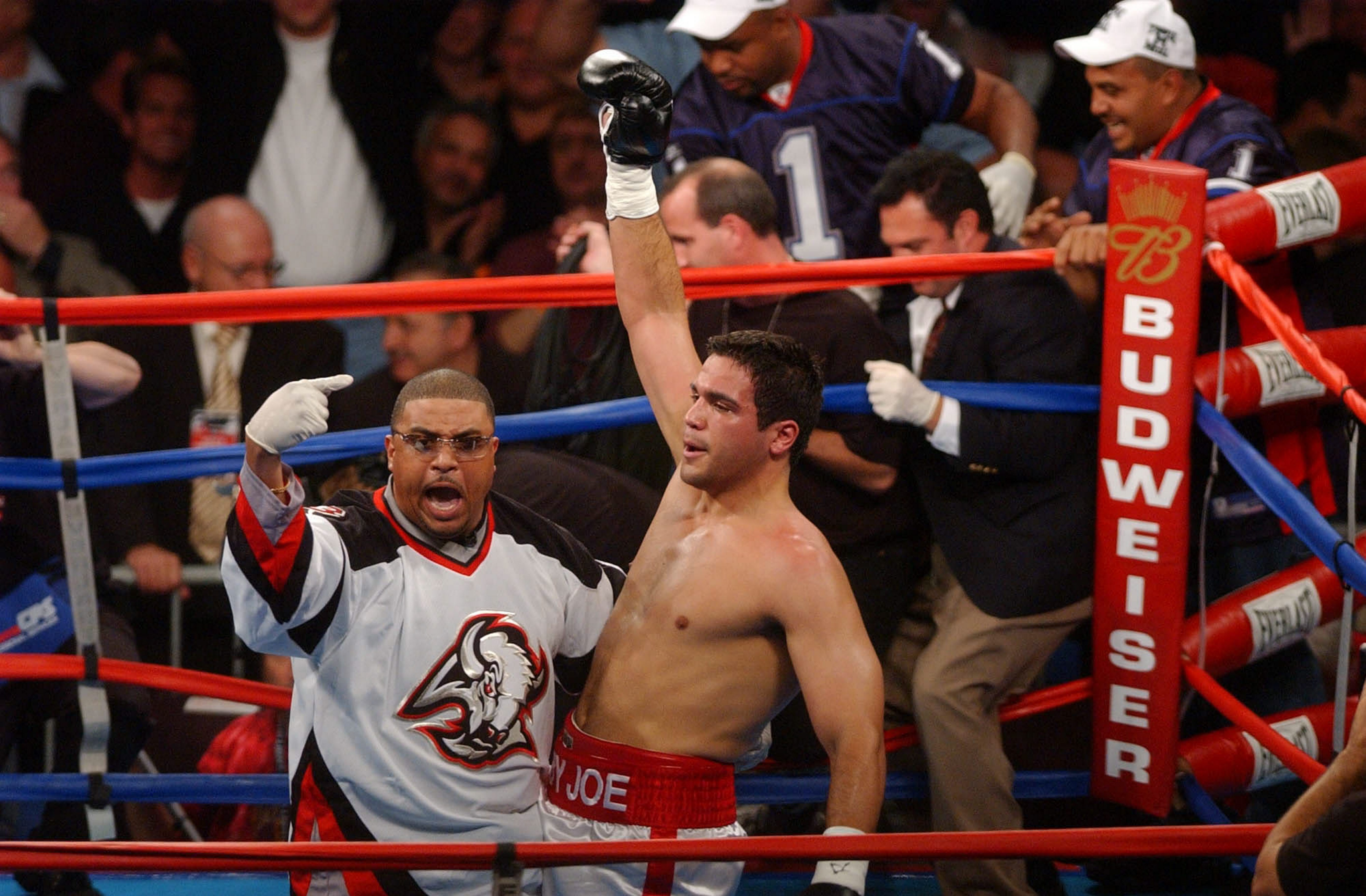 Trainer Juan DeLeon celebrates with Baby Joe Mesi after his first-round knockout of DaVarryl Williamson at then-HSBC Arena on Sept. 27, 2003.