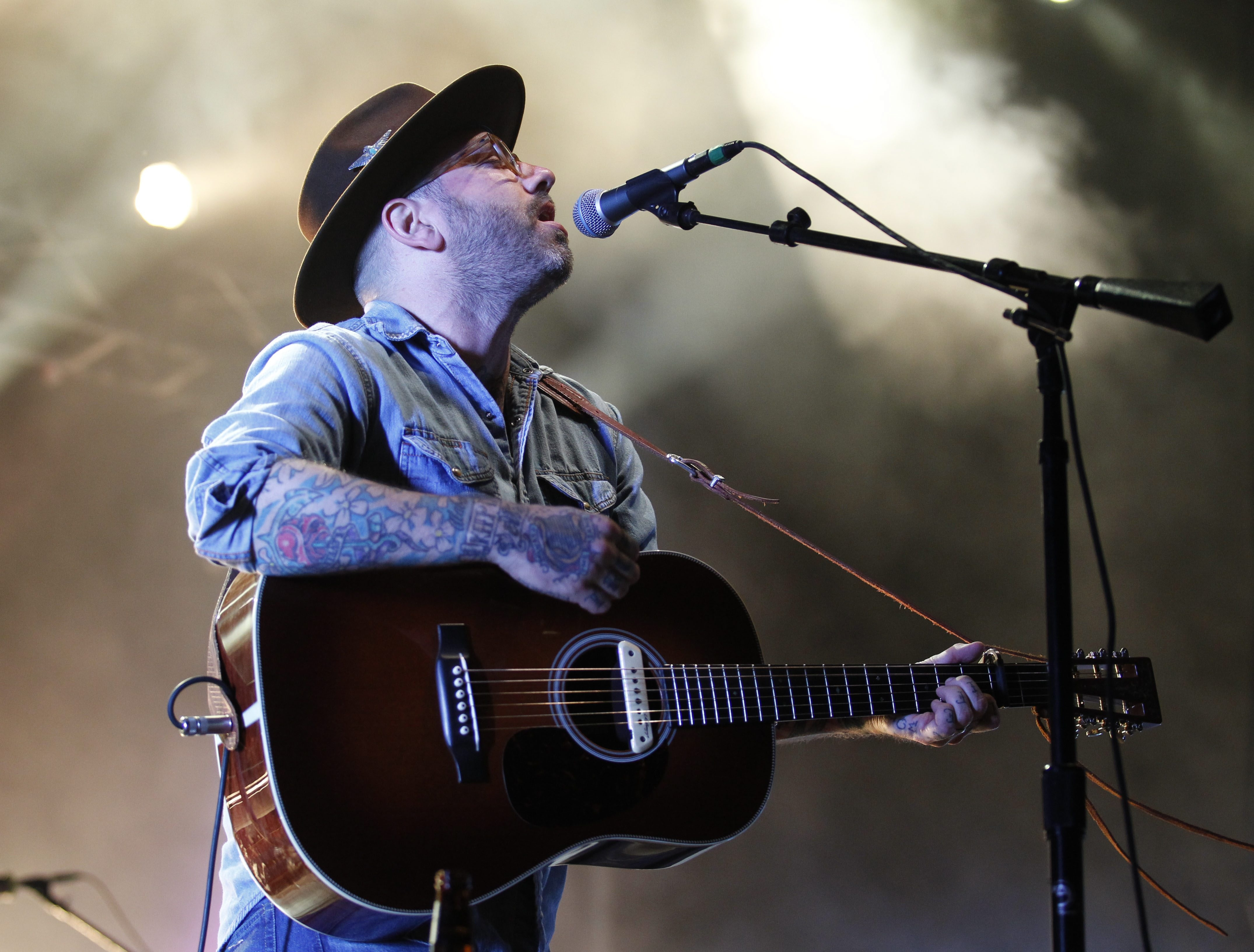 Canadian singer songwriter City and Colour was the headliner of the multi-band show at the Outer Harbor, Friday, July 11, 2014. City and Colour is the recording alias for Dallas Green.  He plays acoustic and folk music and is often accompanied by a rotating number of Canadian indie rock musicians. (Sharon Cantillon/Buffalo News)