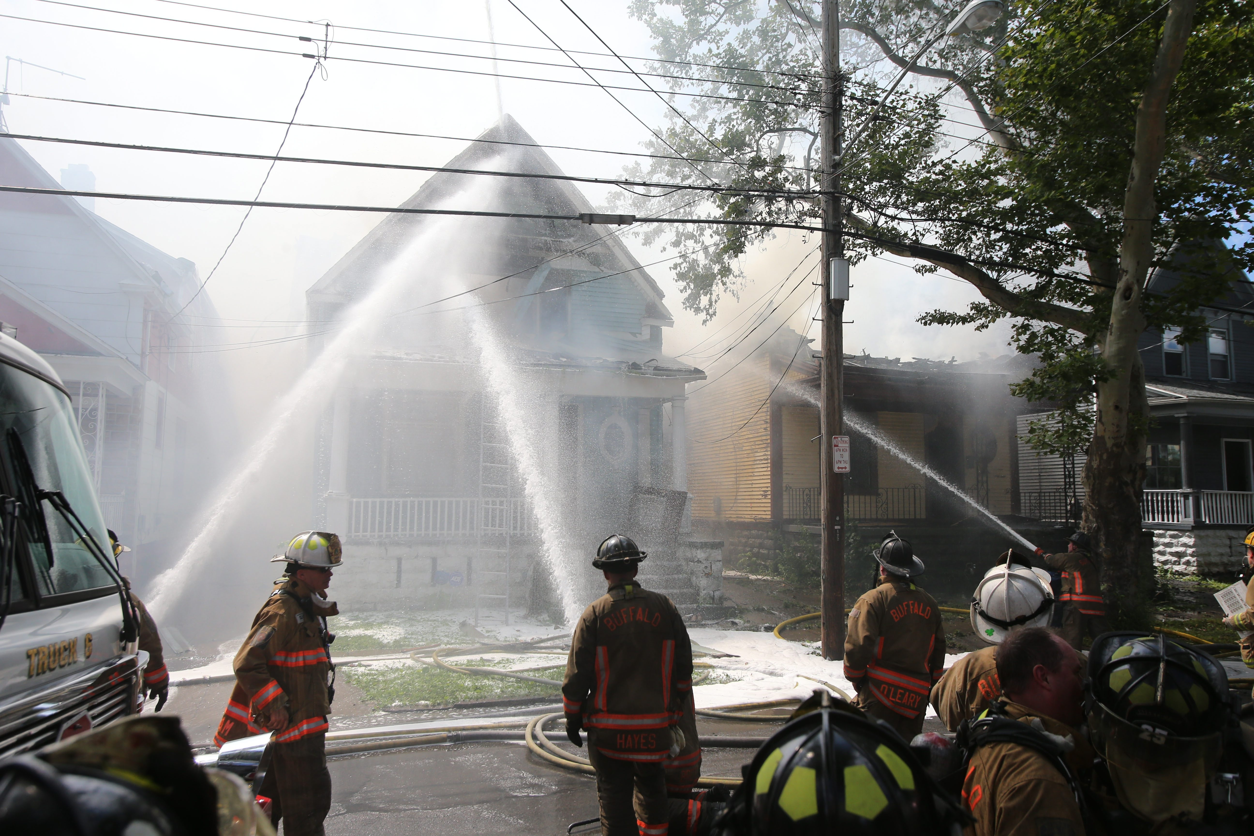 Buffalo firefighters tackle a fire that destroyed two houses and damaged a third Thursday on Moselle Street. See a photo gallery at BuffaloNews.com.