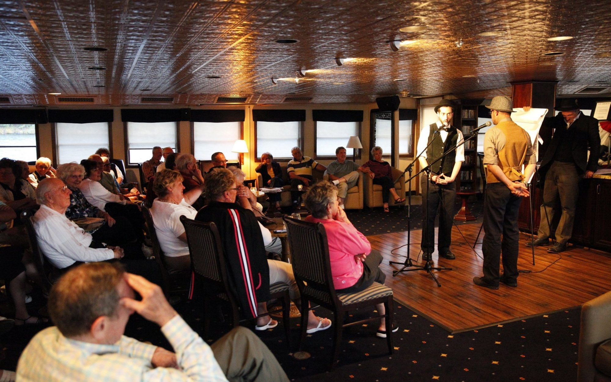 "Guests enjoy entertainment of ""Open Mic Night"" in the Grand Salon aboard the S.S. Legacy while cruising the Columbia, Snake & Willamette Rivers traveling nearly 1,000 miles roundtrip from Portland, Ore, on June 4, 2014, during an Un-Cruise Legacy of Discovery tour. (Al Seib/Los Angeles Times/MCT)"