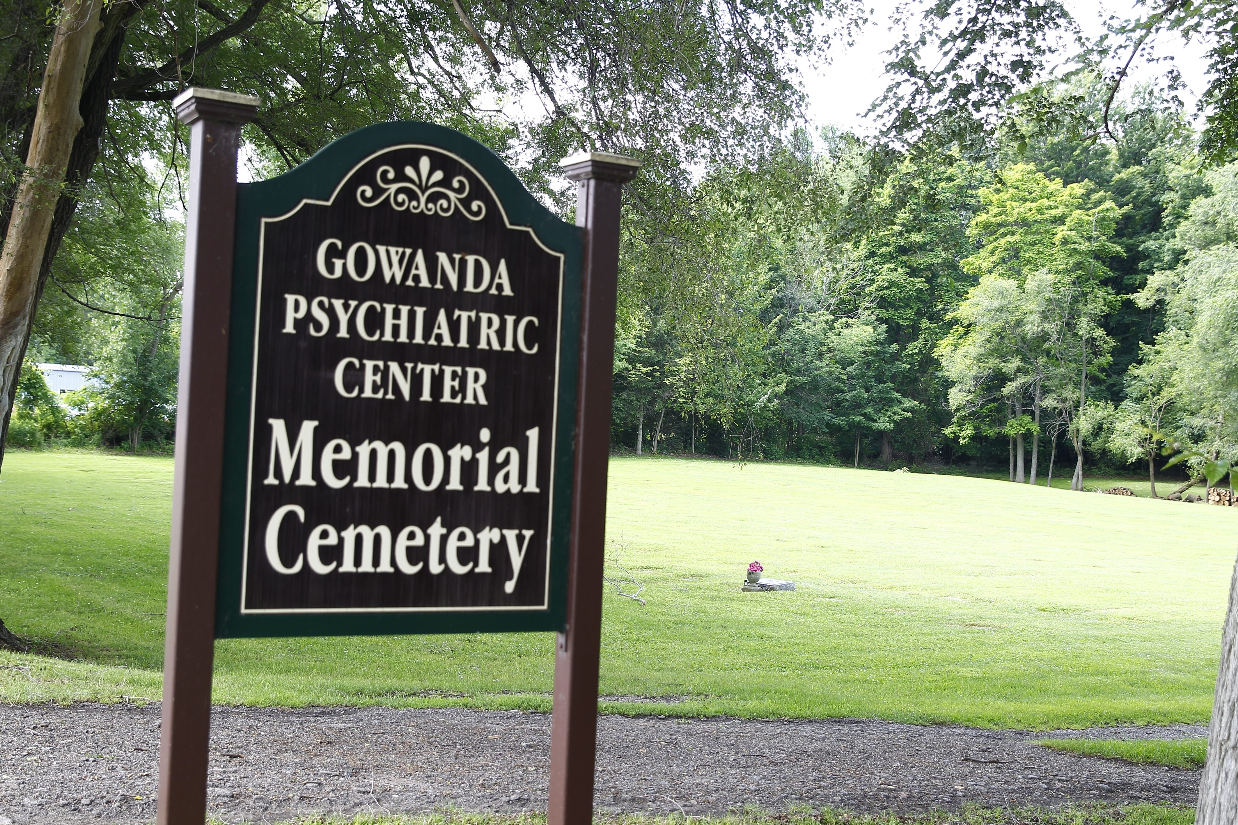 Above, restoration of asylum cemeteries and legislation to make records available to family members are underway for cemeteries like Gowanda Psychiatric Center Memorial Cemetery. Left, Angeline Wnek's resting place.
