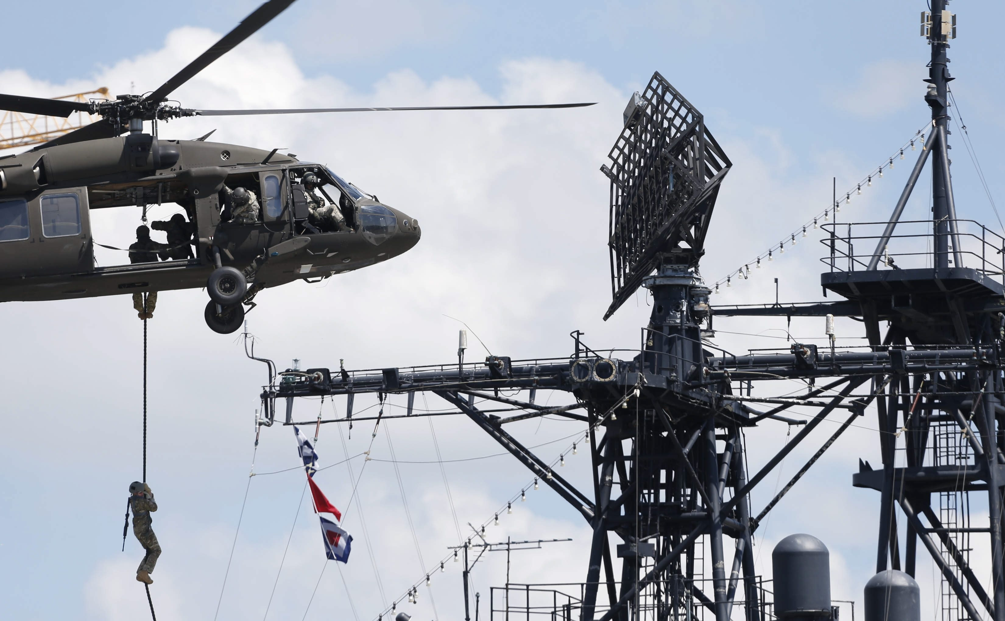 A pair of assault teams rappelled from Black Hawk helicopters onto the deck of the USS Little Rock at the Naval and Military Park in the Erie Basin Marina on Thursday.  The solders from West Virginia were conducting a military exercise.