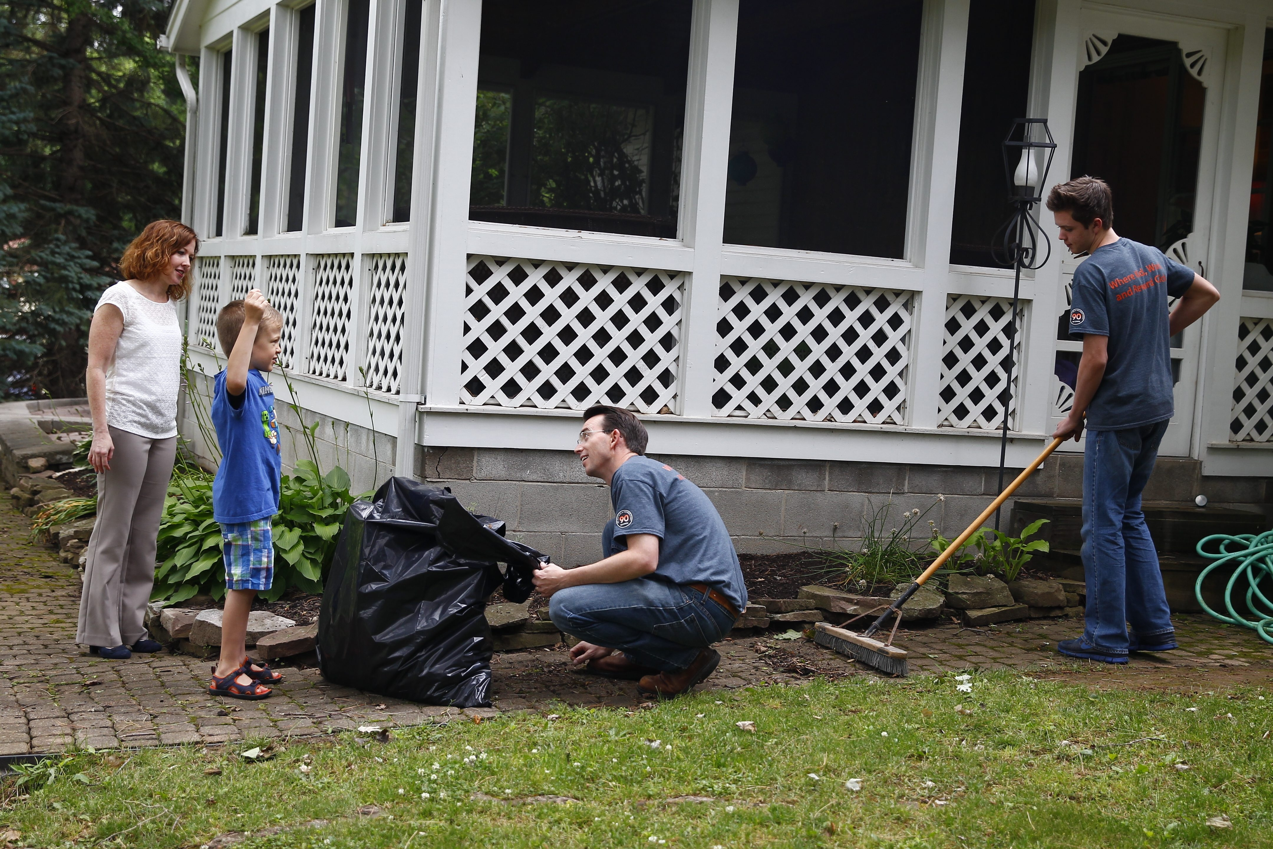 Caroline Lewandowski, left, and her son, Mike, 6, talk with Gregg Murset and his son Zach, of Arizona, who stopped Wednesday at the Lewanowski home in Lockport to help them with chores.