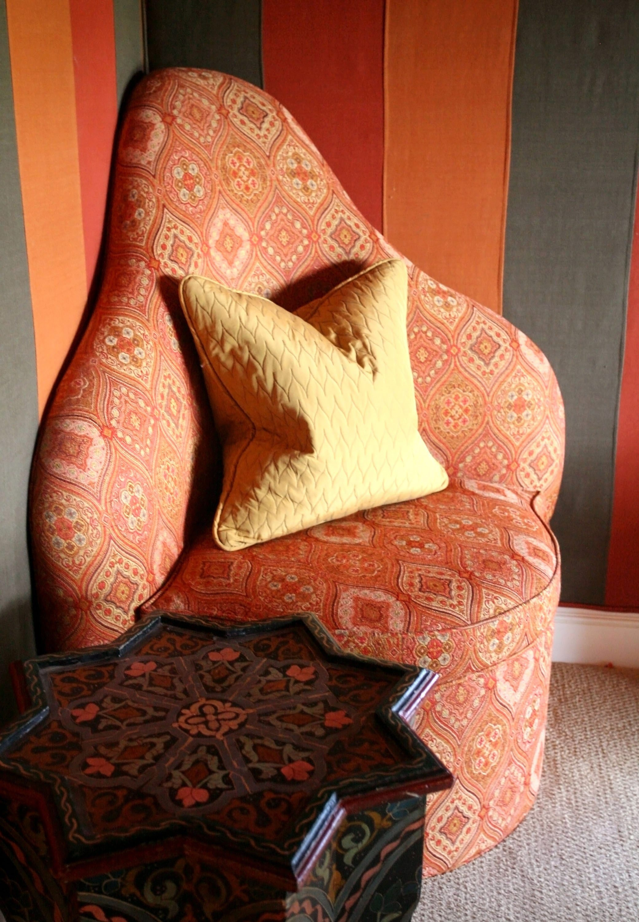 Turkish chairs rest in the corners of a Moroccan-themed billiard room. (Jacob Langston/Orlando Sentinel/MCT)