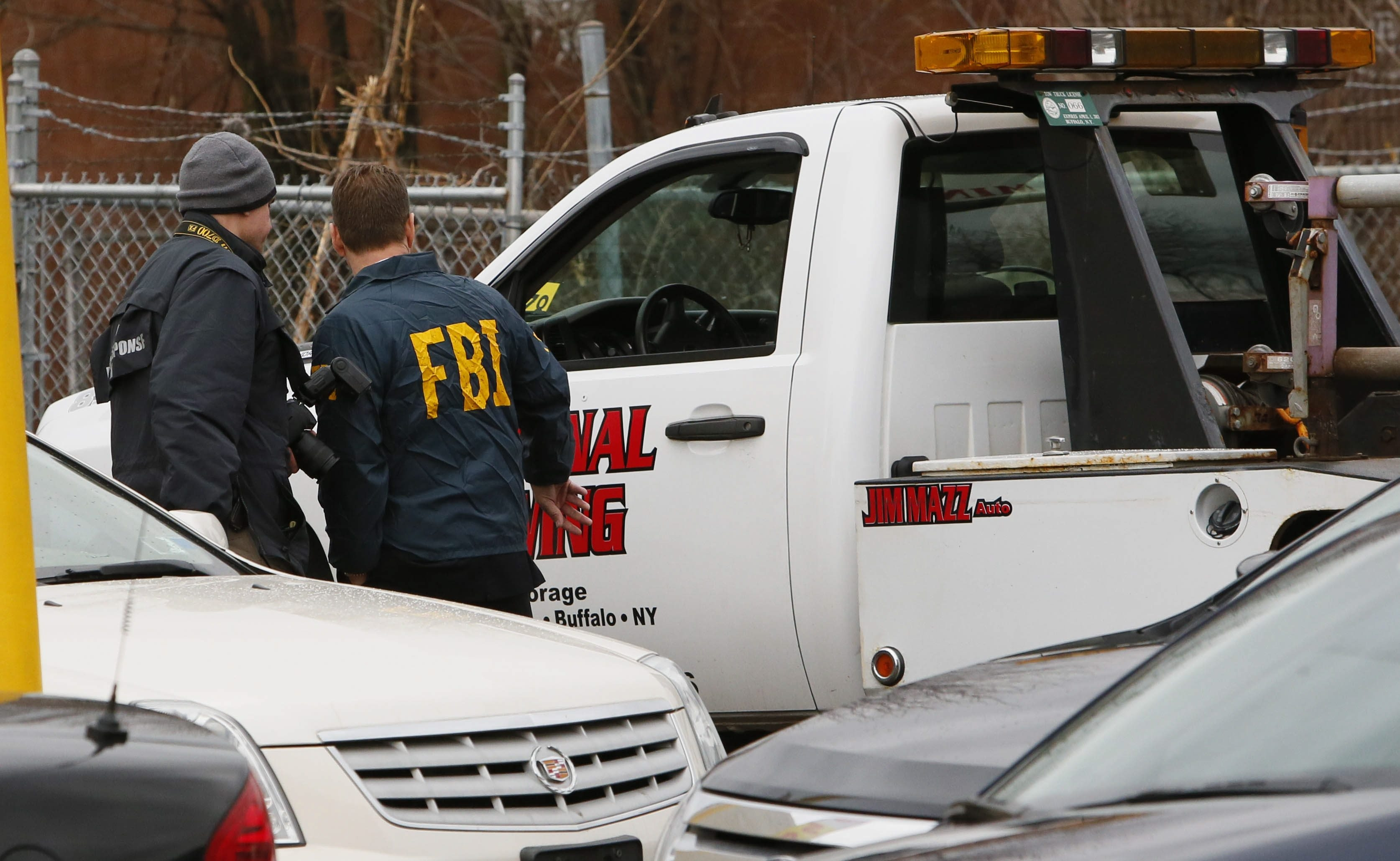 FBI Evidence Response Team members collect evidence while executing a search warrant at Jim Mazz Auto on Bailey Avenue in the city's Lovejoy neighborhood, Wednesday, Dec. 5, 2012. (Derek Gee/Buffalo News file photo)