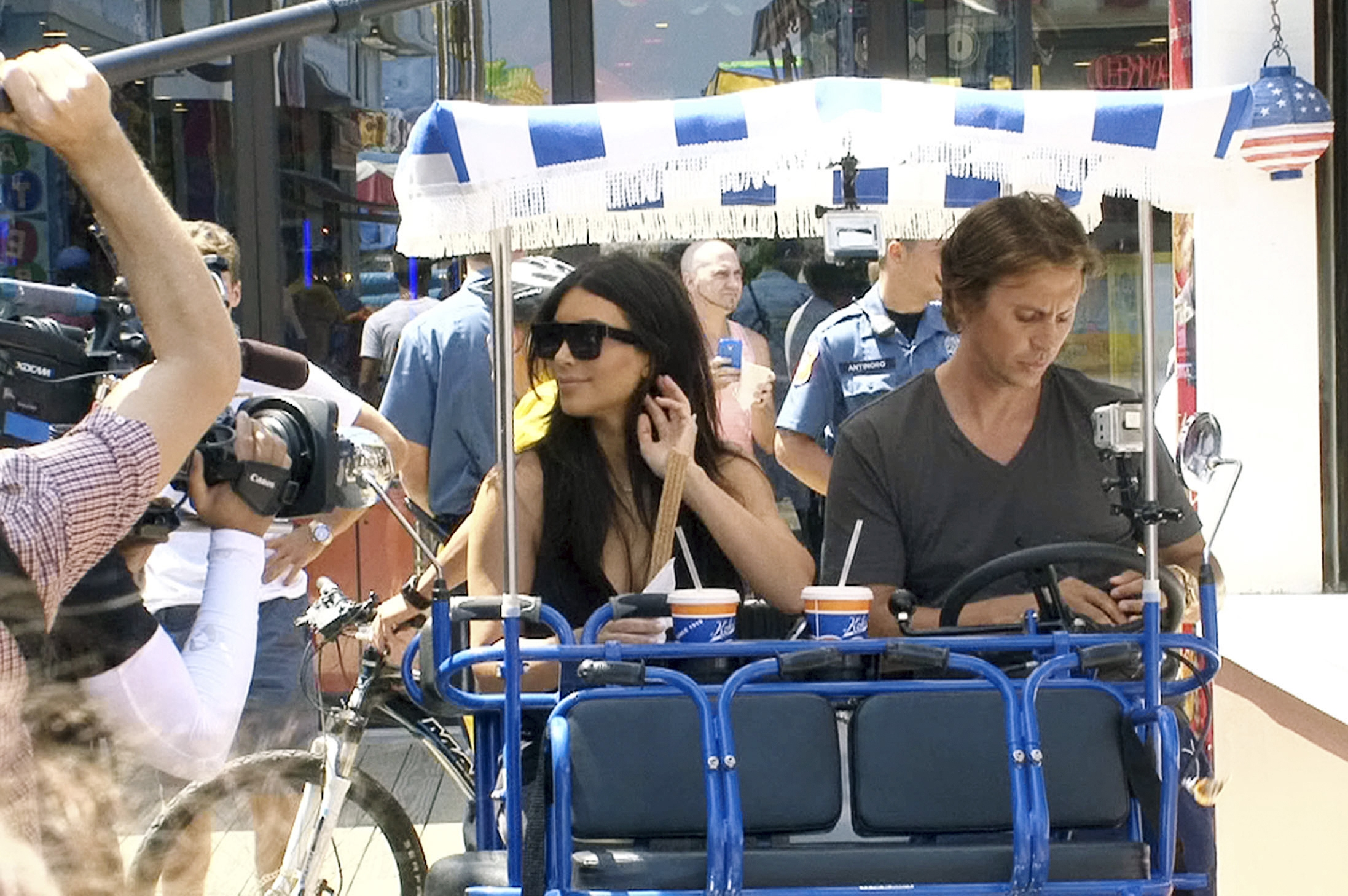 Kim Kardashian and her friend and publicist Jonathan Cheban ride a surrey on the Seaside Heights, N.J., boardwalk Tuesday.