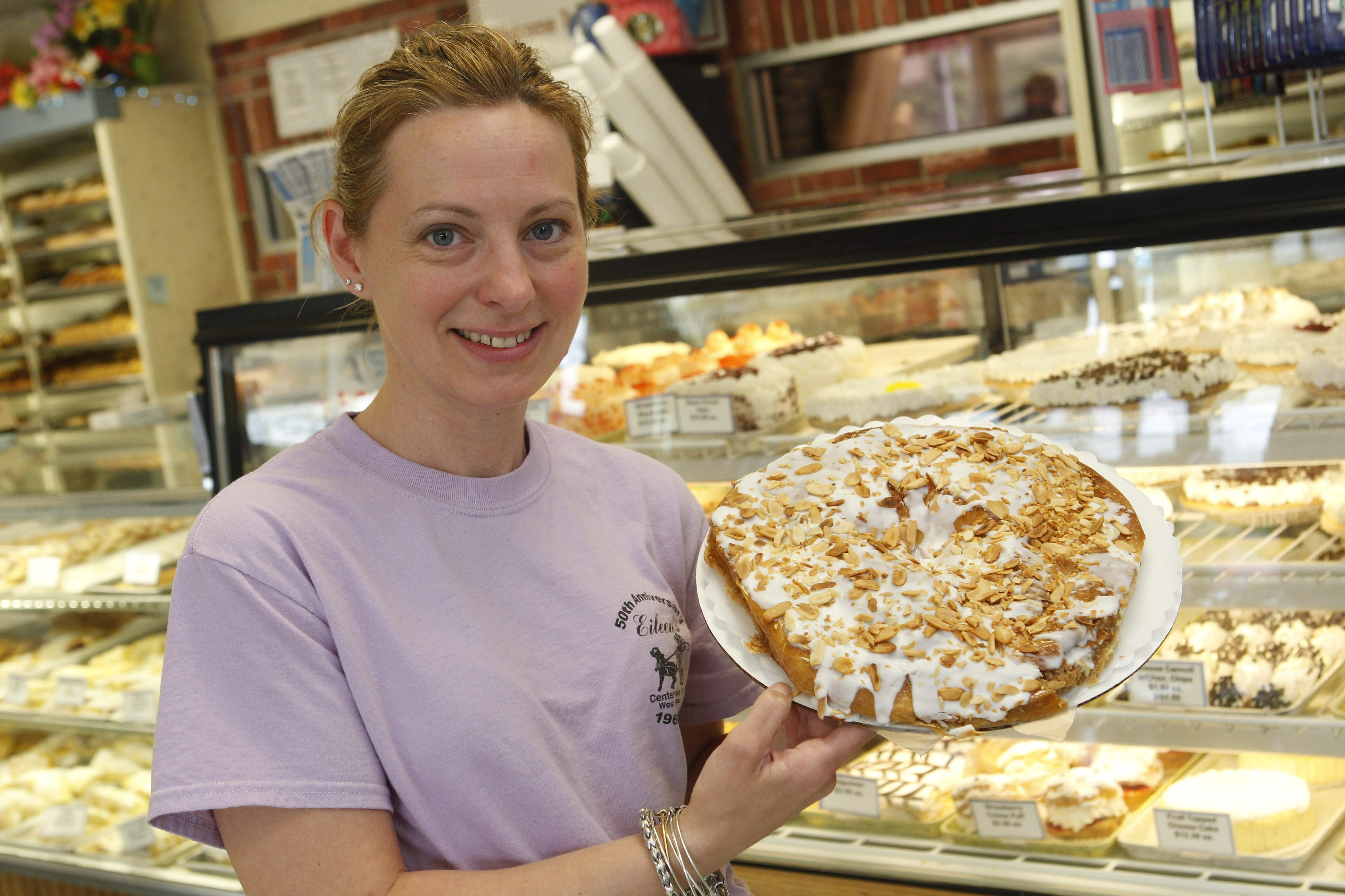 Eileen's Centerview Bakery in West Seneca is celebrating its 50th anniversary this year. Carol Frick, whose grandmother started the bakery, presents the almond ring.