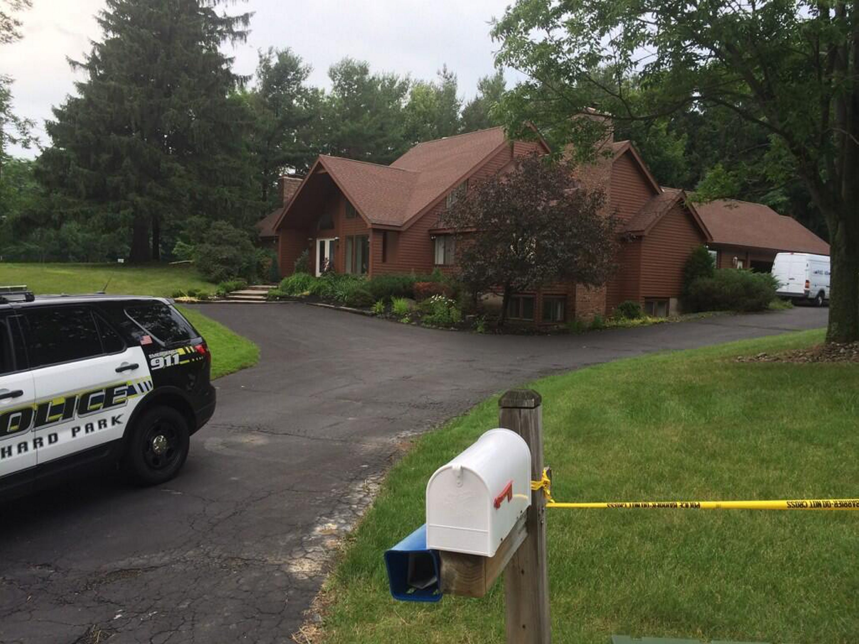 Police at the scene at 2 Hillsboro Drive, Orchard Park, Monday night.