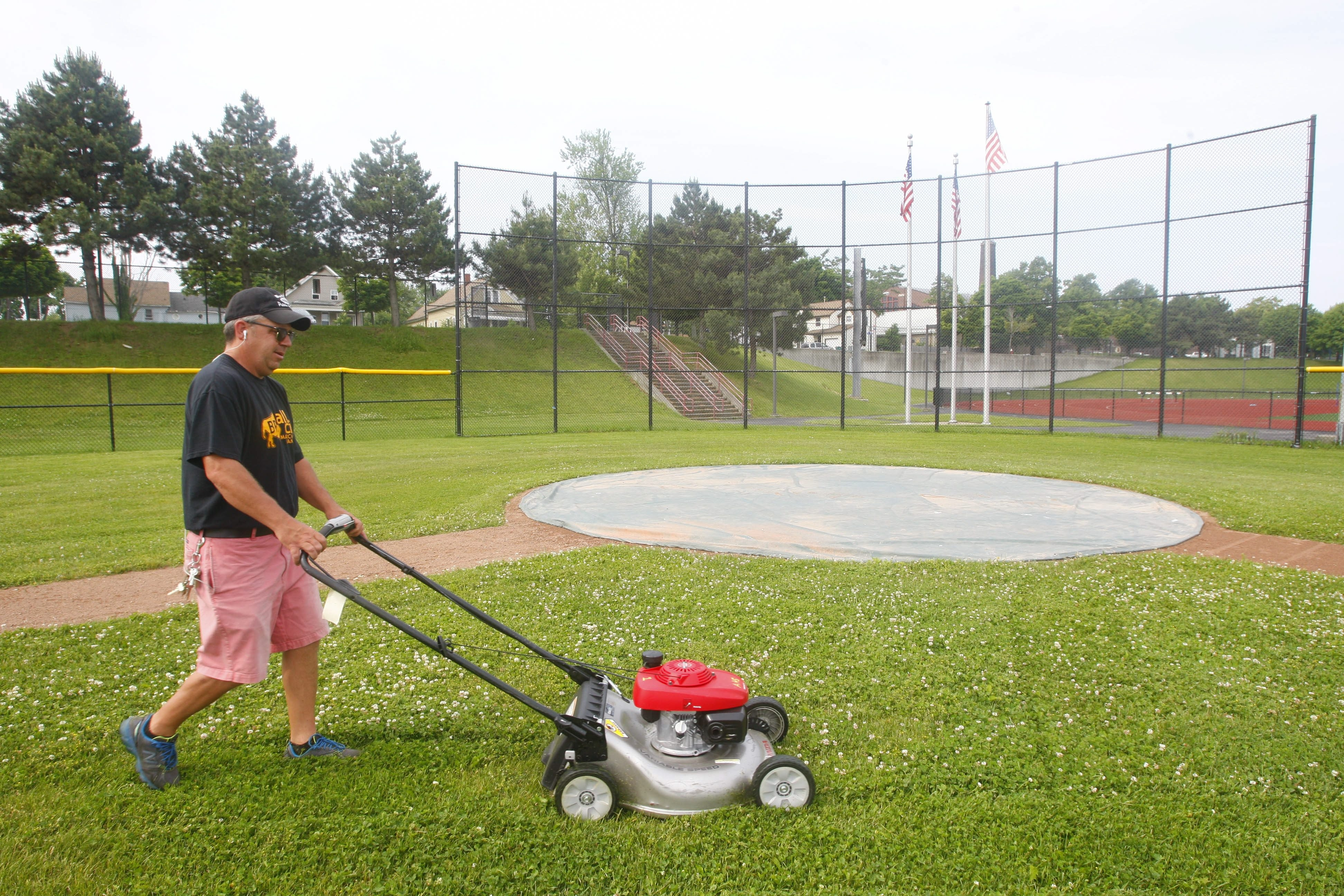Tom Trevean of the Buffalo Public School grounds department mows the infield of the baseball field at Johnnie B. Wiley Stadium.  (Derek Gee/Buffalo News)