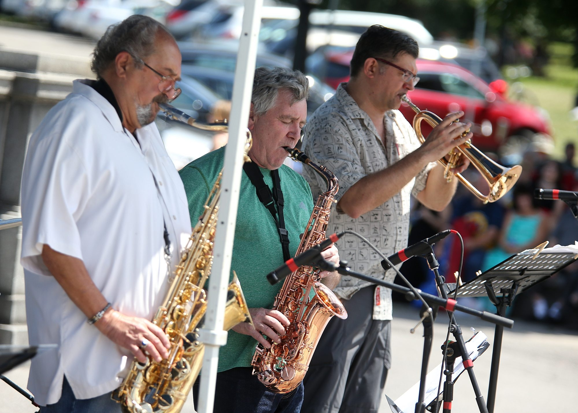Bandleader Phil DiRe' on tenor saxophone, Jay Beckenstein on alto saxophone and Tim Clark on trumpet performed outside the Albright-Knox Art Gallery on Sunday. (Charles Lewis/Buffalo News)