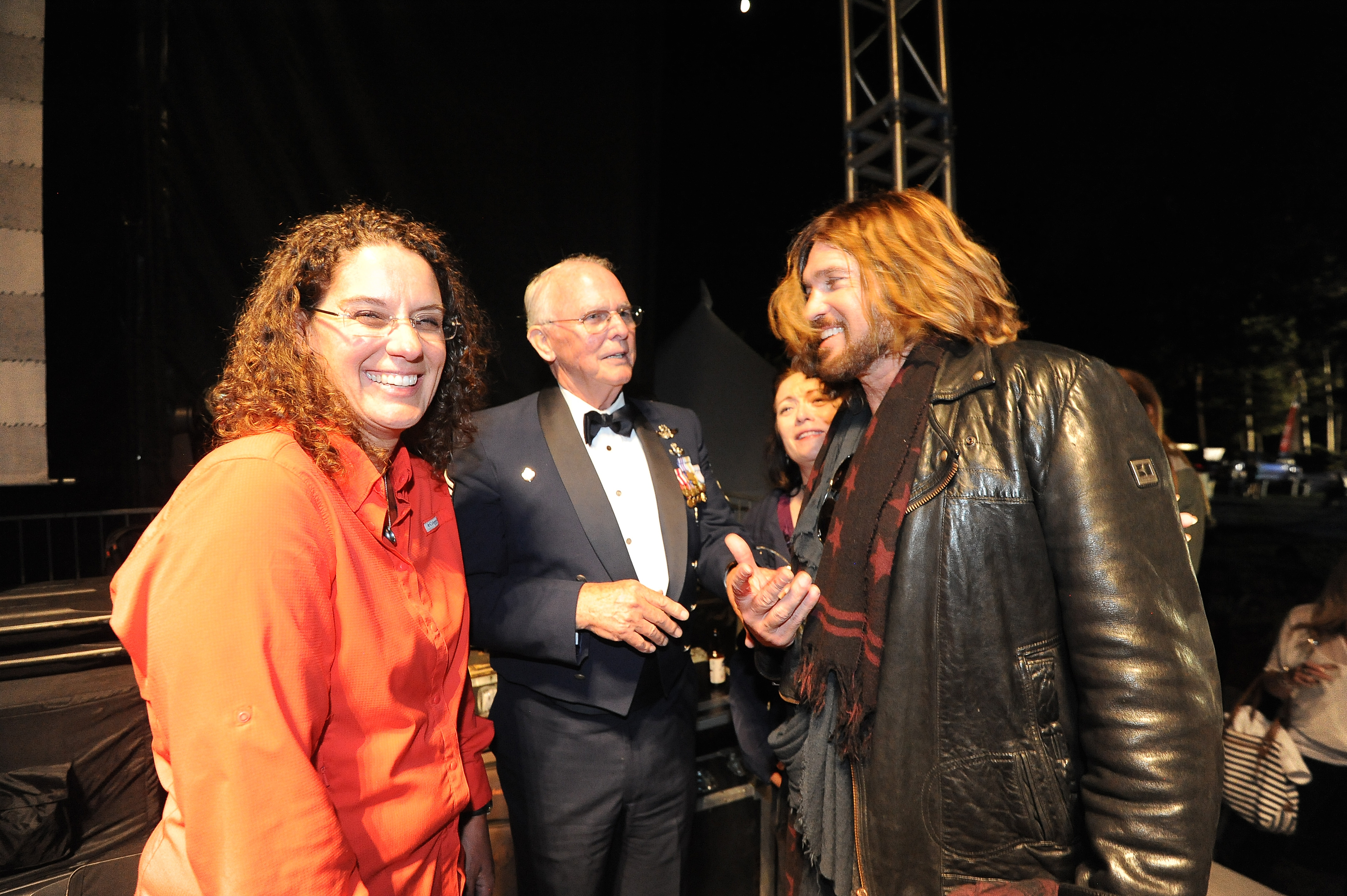 Billy Ray Cyrus, right, chats with Sharon Landsberry, left, and other guests at a concert in Lake Tahoe on Saturday. He presented a plaque and a check to Landsberry.