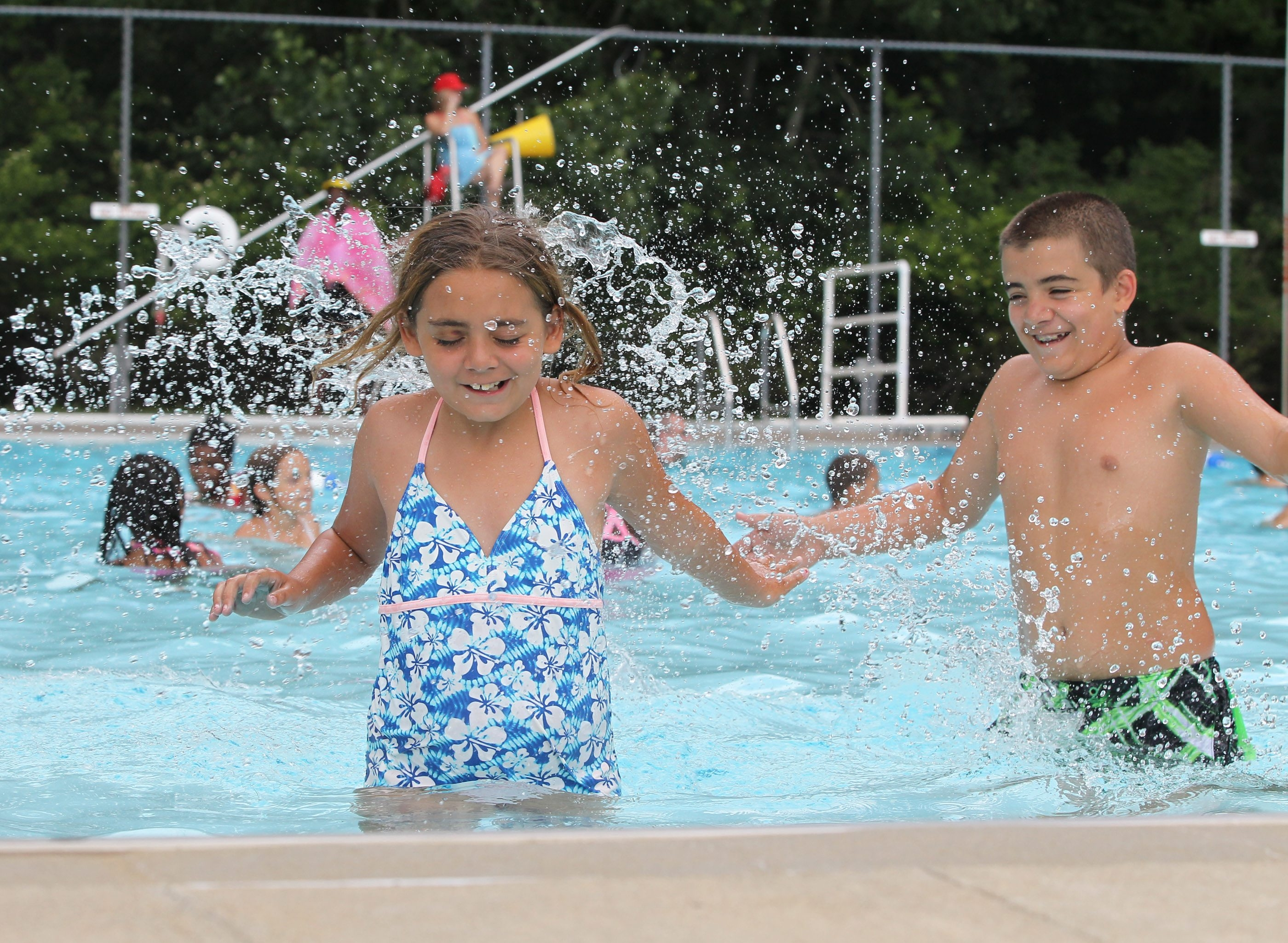 Angelina Jones, 9, and brother Eric, 11, enjoy the pool at Cradle Beach Camp on Friday. Both children, along with another brother, David, 12, are enrolled in SOAR, the camp's year-round mentoring program.