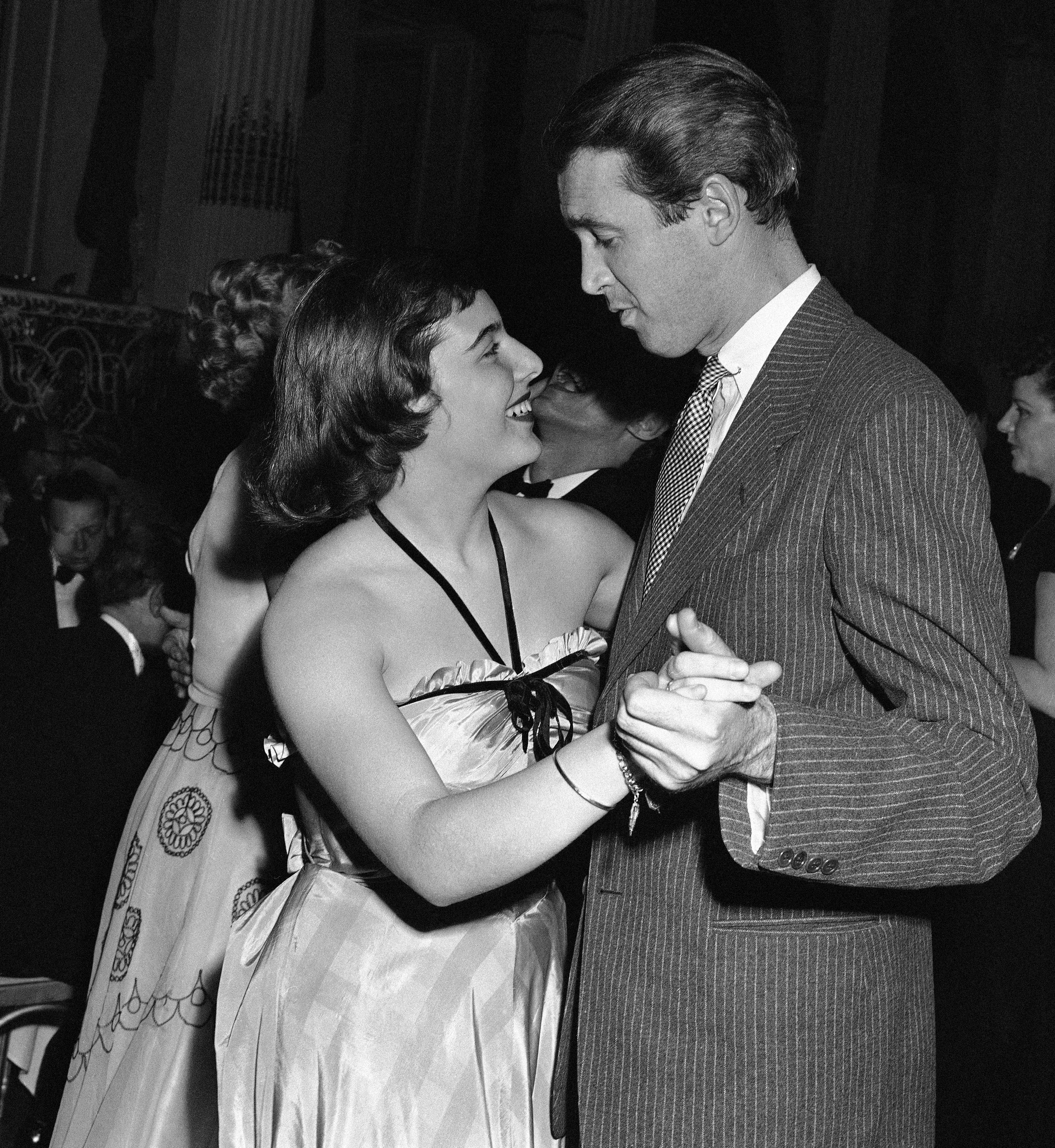 "Mary Rodgers dances with movie star Jimmy Stewart at the fifth anniversary party for the musical ""Oklahoma!"" at the Plaza Hotel in New York in April 1943."