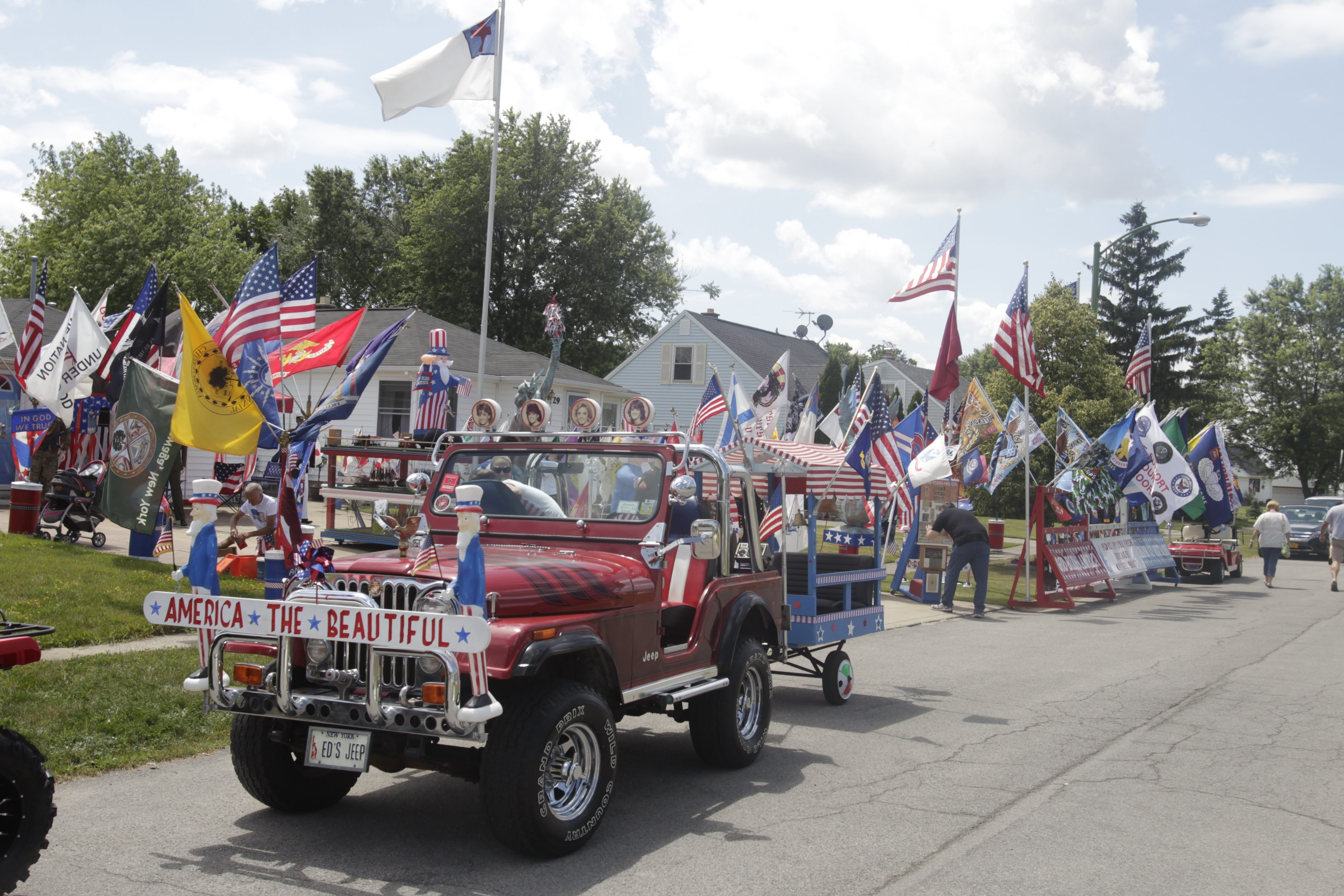 Ed Krier decorated his Jeep, trailer and house on Nokomis Parkway in Cheektowaga with over 300 flags to celebrate the Fourth of July.
