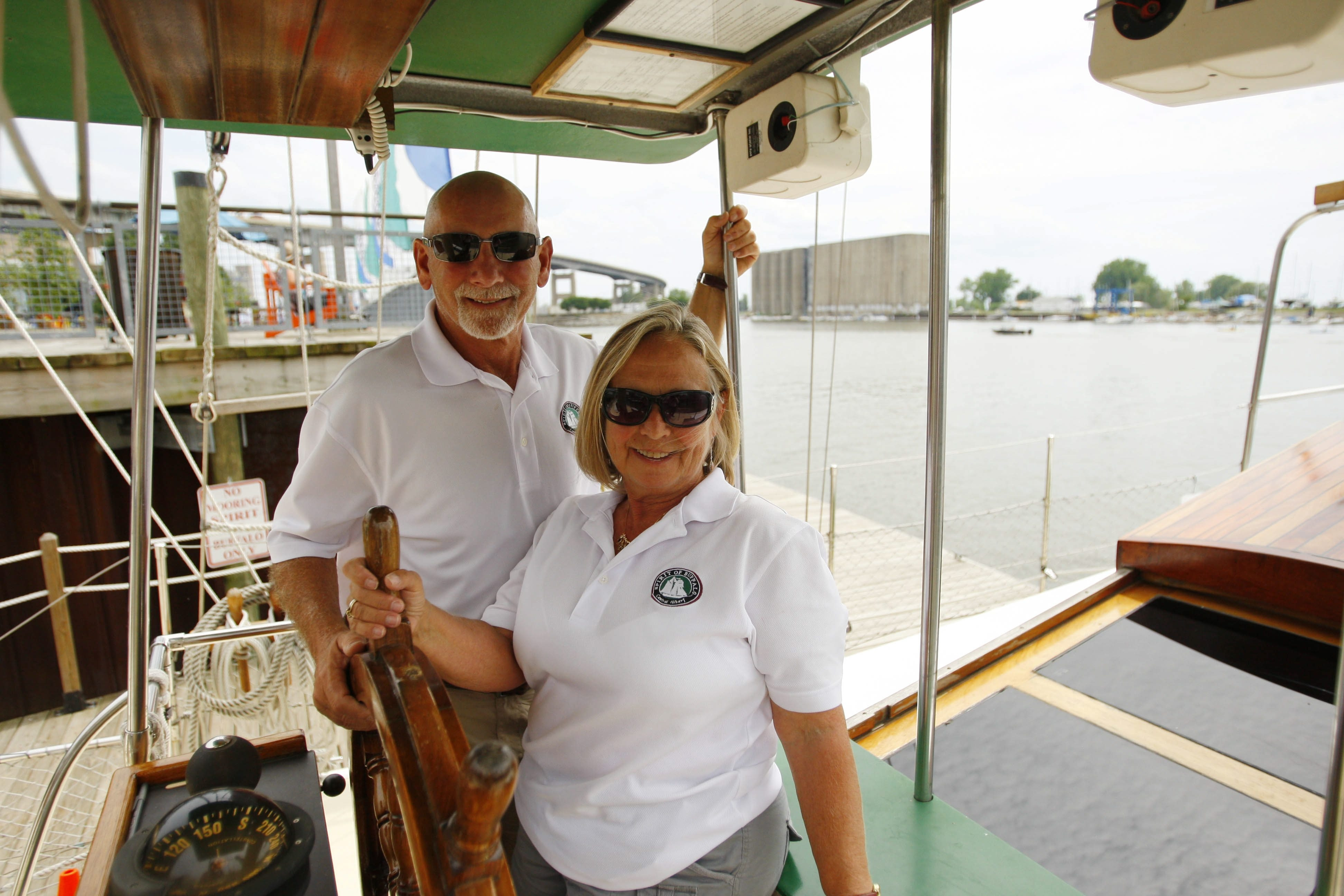 Ric and Kathy Hilliman, behind the wheel of the Spirit of Buffalo, used all their resources in 2008 to come up with the money to purchase the boat – and then the stock market crashed.