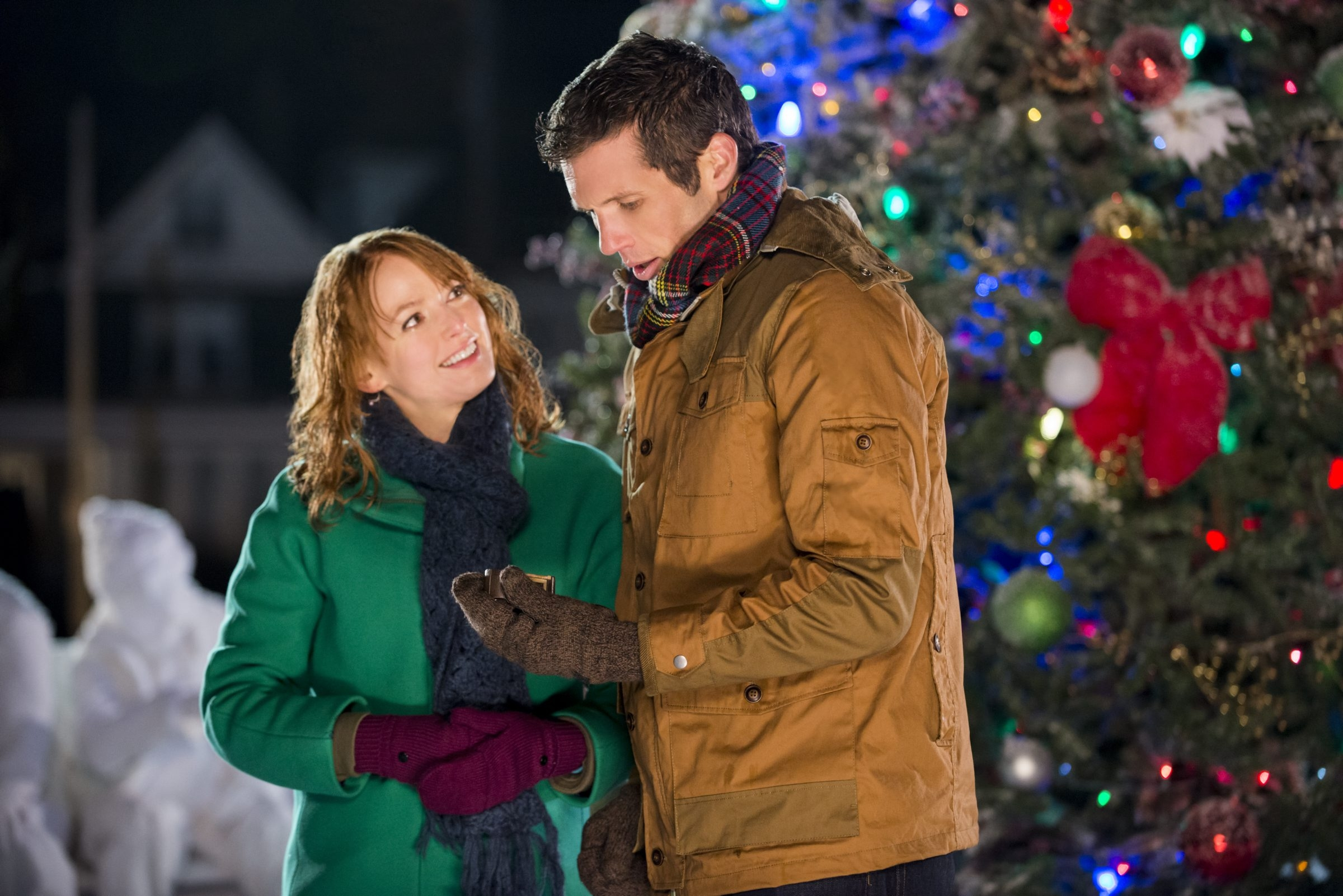 "Alicia Witt and Mark Wiebe star in ""A Very Merry Mix-Up,"" part of the Hallmark Channel's Christmas Keepsake movie festival airing through July 13."