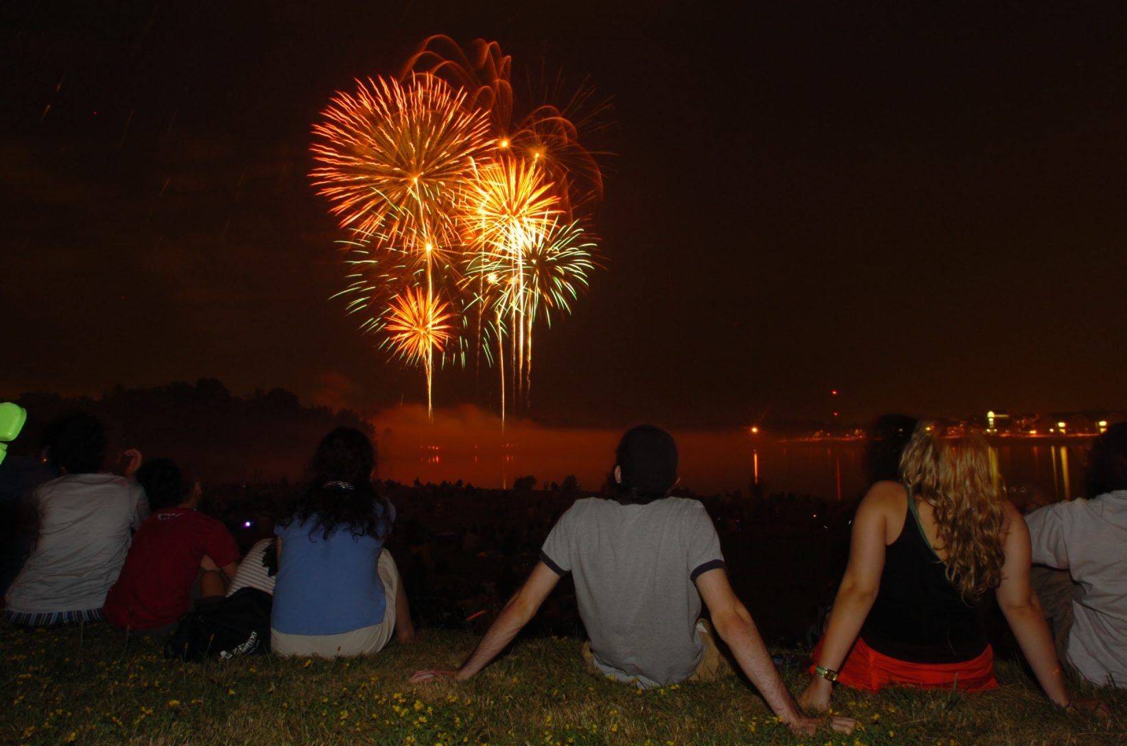 Spectators watch the fireworks display over  Baird Point on the University at Buffalo Amherst Campus in 2005.