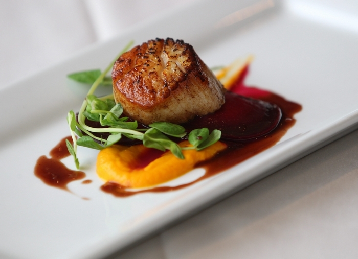 Scallop with beet ravioli and red wine reduction with carrot puree from Curly's Bar. (Photo by Sharon Cantillon / The Buffalo News)