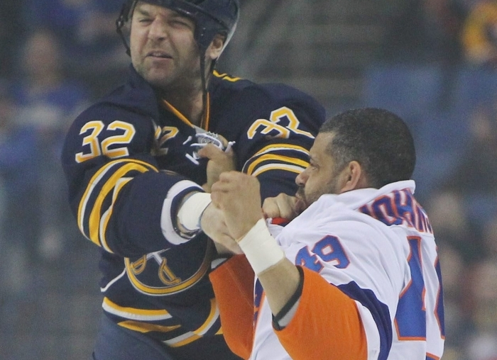 The Sabres' John Scott tangles with the Islanders' Justin Johnson during a first-period fight. (Mark Mulville/Buffalo News)
