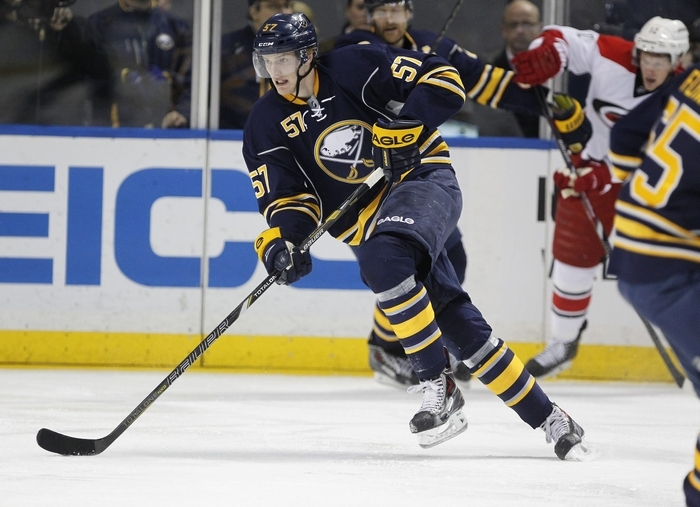 The Sabres' Tyler Myers is excited to be back after Buffalo's busy summer. (Harry Scull Jr./Buffalo News)
