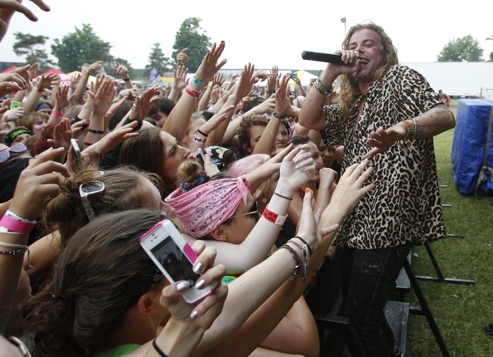 Fans reach out to hip-hop artist Mod Sun on Tuesday at the Vans Warped Tour at Darien Lake Performing Arts Center. The event featured more than 100 acts on 10 stages over 11 hours. See a concert photo gallery at BuffaloNews.com. (Sharon Cantillon/Buffalo News)