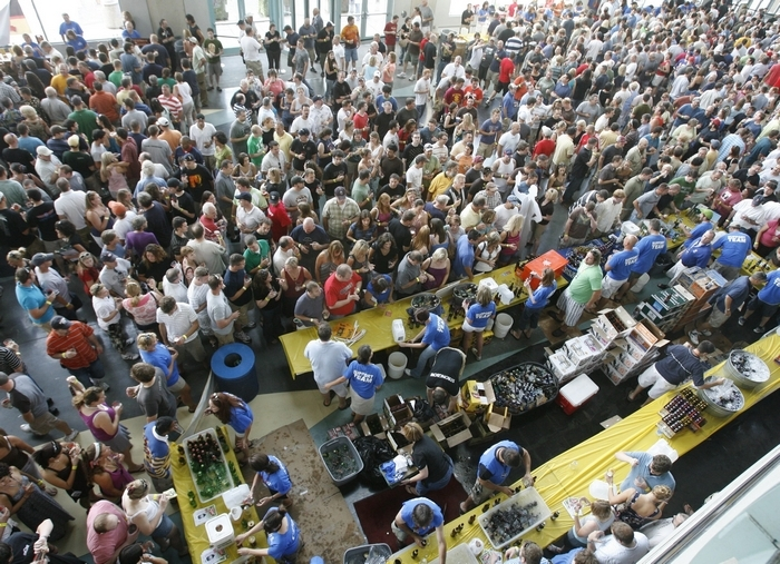 A thirsty mob showed up for a past indoor Brewfest. The festival in August will move outdoors, from First Niagara Center to the Cobblestone District. (Buffalo News file photo)