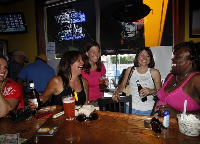 Enjoying a laugh and some drinks at Sidelines Sports Bar and Grill on Delaware Avenue are, from left, Joanne DiPasquale, Wendy Collier, Cheryl Campbell, Delilah Ventura and Cece Knight. (Photos by Sharon Cantillon/Buffalo News)