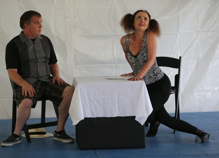 Priscilla Young-Anker, right, and Ronald J. Leonardi, run a scene during a dress rehearsal for the Buffalo Repertory Awards Theater One-Act plays, at Canalside in Buffalo, Friday, July 25, 2014. (Charles Lewis/Buffalo News)