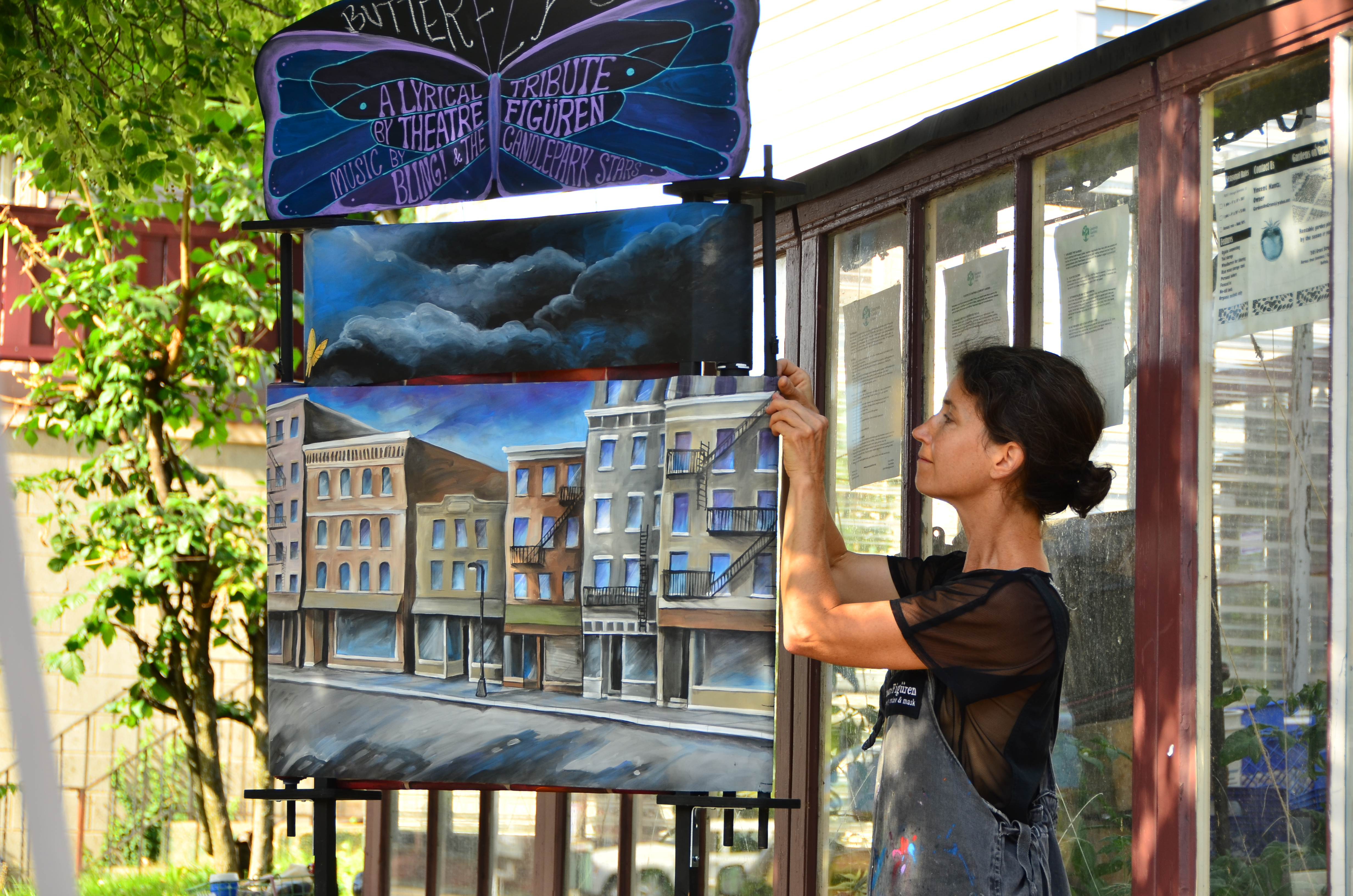 """Michele Costa performs her show """"Butterfly Sky"""" on the Grant Street sidewalk during the 10th annual Buffalo Infringement Festival."""