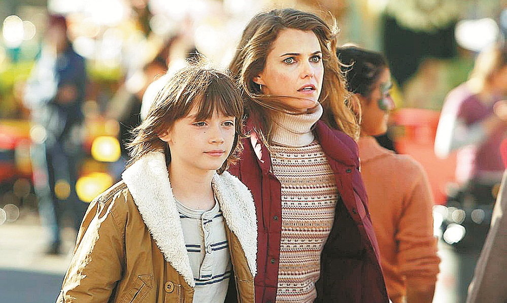 "Keidrich Sellati, left, and Keri Russell star in ""The Americans"" on FX. (New York Times)"