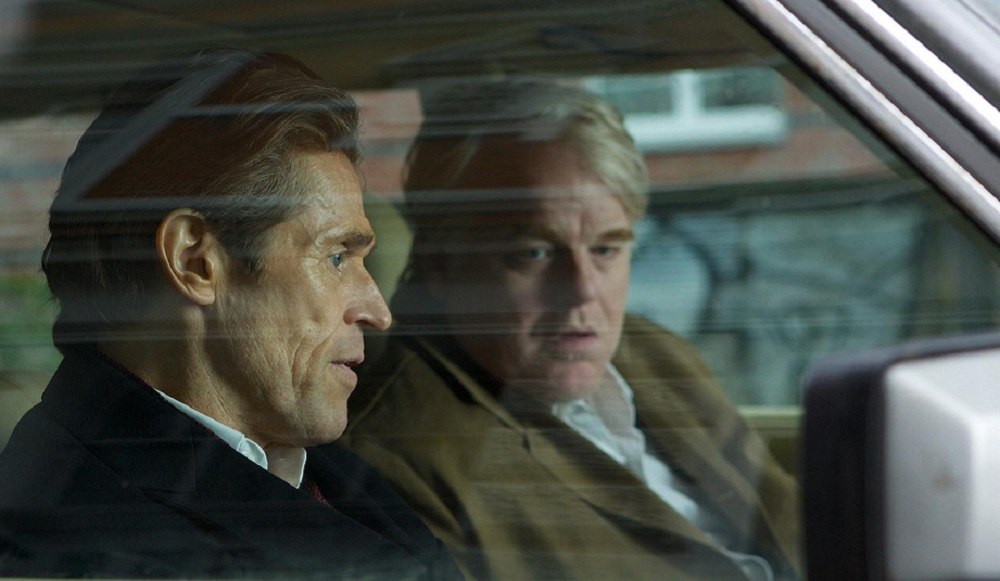 Willem Dafoe, left, and Philip Seymour Hoffman excel as John le Carr's characters.