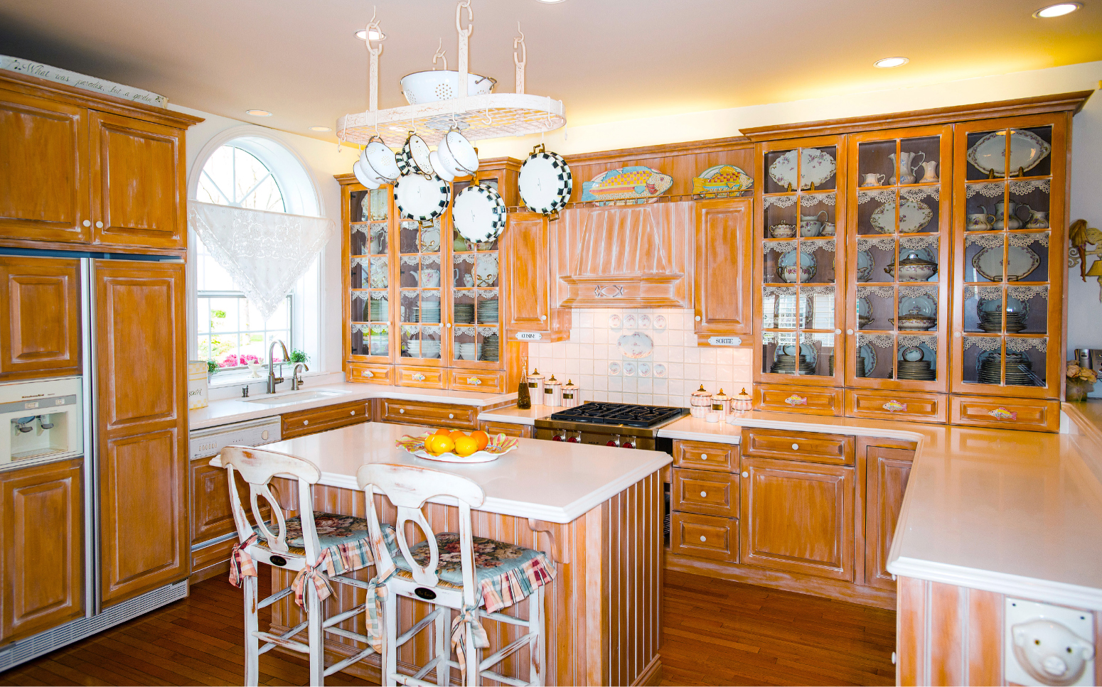 The open kitchen cabinets provide an ideal place to frame Kathy's beloved china collection