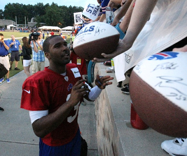 Buffalo Bills quarterback EJ Manuel (3) signs autograph after practice after the Buffalo Bills' first day of training camp last season at St. John Fisher College.  (James P. McCoy/ Buffalo News)