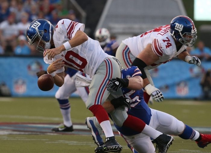 Bills tackle Kyle Williams sacks Giants quarterback Eli Manning and causes a fumble that Buffalo recovered, leading to an early field goal. (James P. McCoy/Buffalo News)