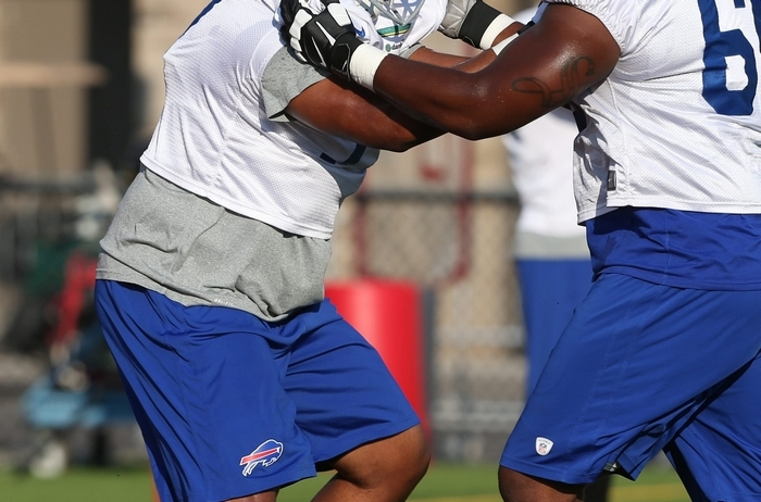 Bills left tackle Cordy Glenn works out for the first time in a Bills night practice Saturday after he passed his physical and was put on the active roster. (James P. McCoy/Buffalo News)