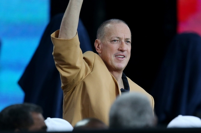 A source close to Jim Kelly – shown above at the Pro Football Hall of Fame induction earlier this month – and bond investor Jeffrey Gundlach said that Kelly met with Bon Jovi face to face in Buffalo last week, but they didn't merge. (James P. McCoy/Buffalo News)