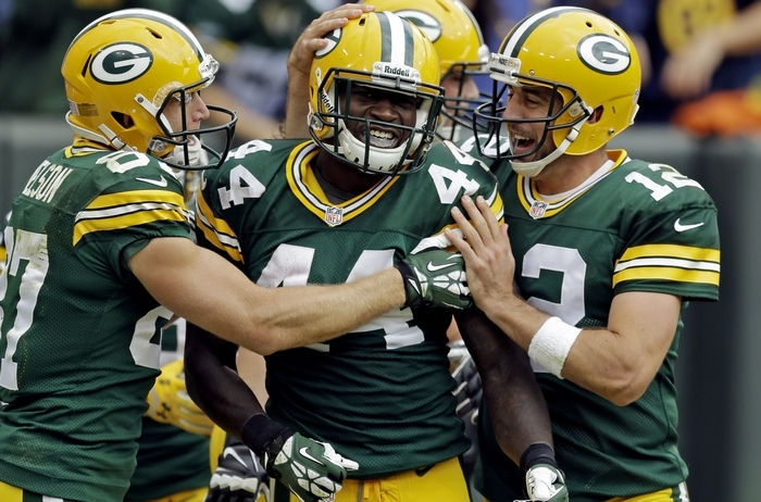 Green Bay hopes to keep scoring and smiling. The Packers' Aaron Rodgers (12) and Jordy Nelson (87) congratulated Niagara Falls native and UB grad James Starks (44) after Starks' TD run early last season. (Associated Press)