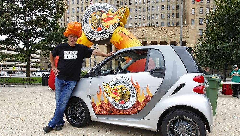 Wing King Drew Cerza posing in front of a wing-themed car in 2014. (John Hickey/Buffalo News file photo)