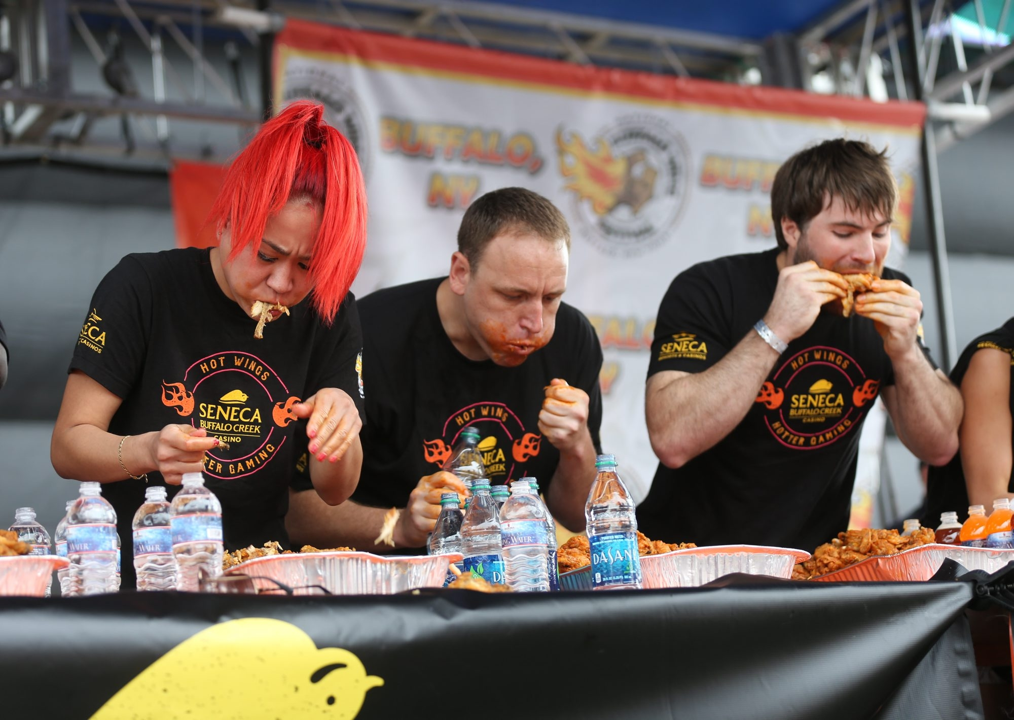Miki Sudo and Joey Chestnut compete in the U.S. National Buffalo Wing-Eating Championship.