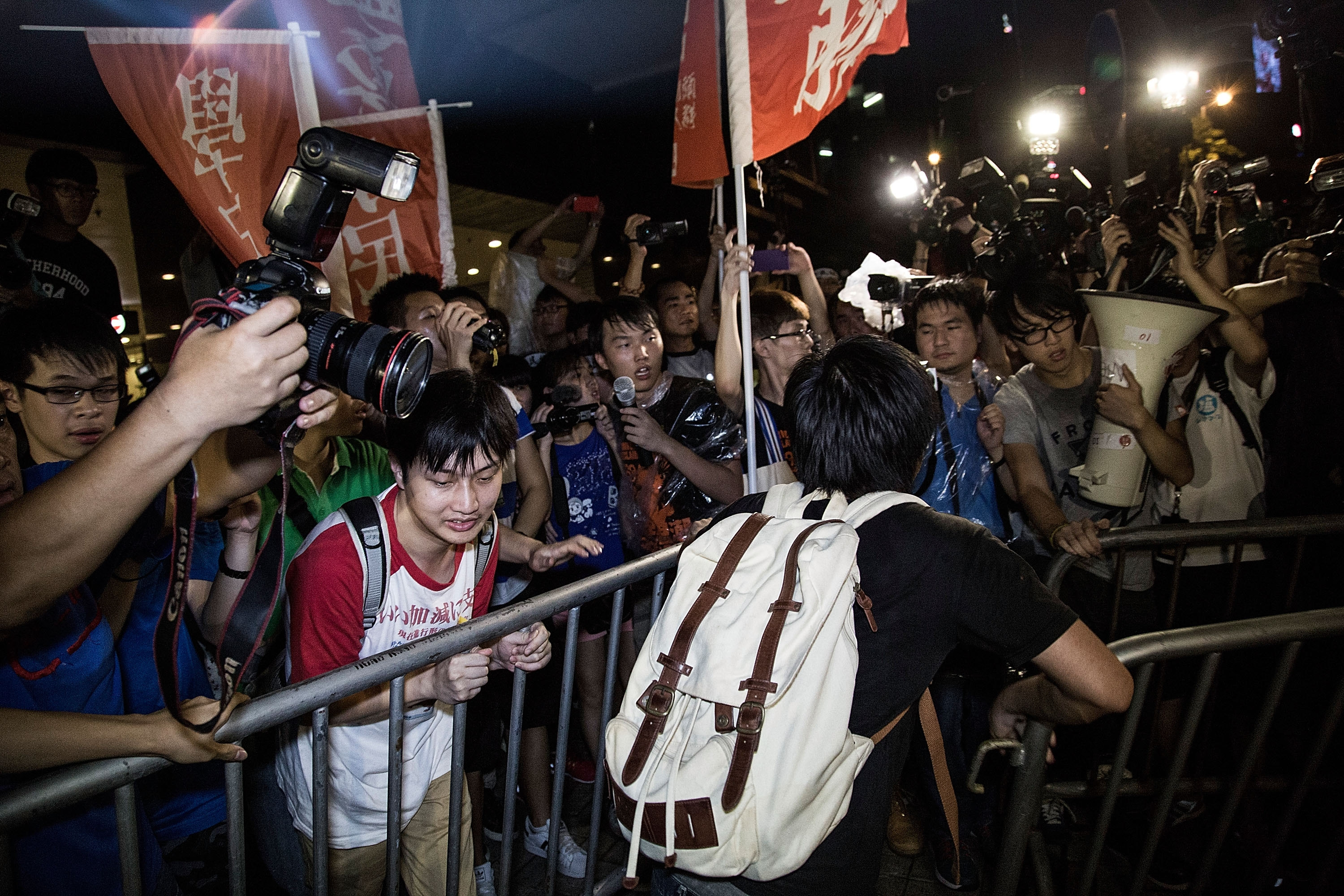 Occupy Central protesters confront police Sunday in Hong Kong. The National People's Congress Standing Committee endorsed an unpopular framework for political reform.